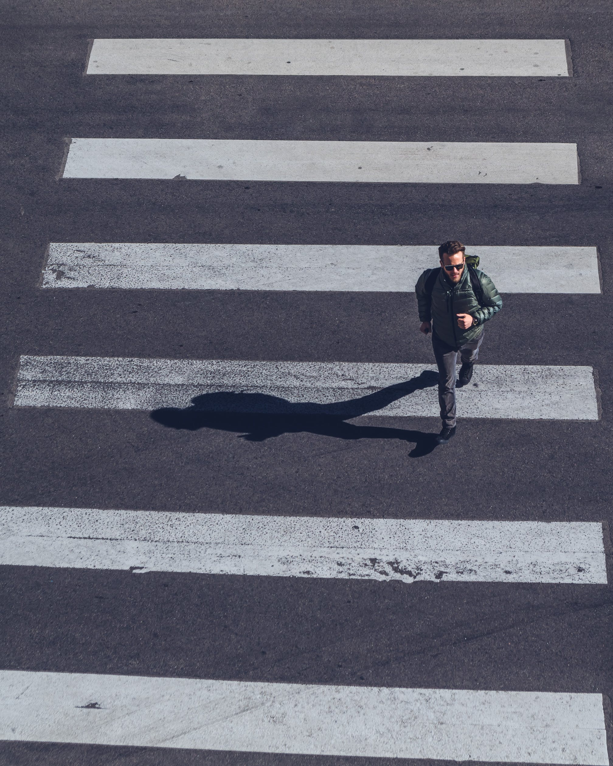 Man Crossing on Pedestrian Lane