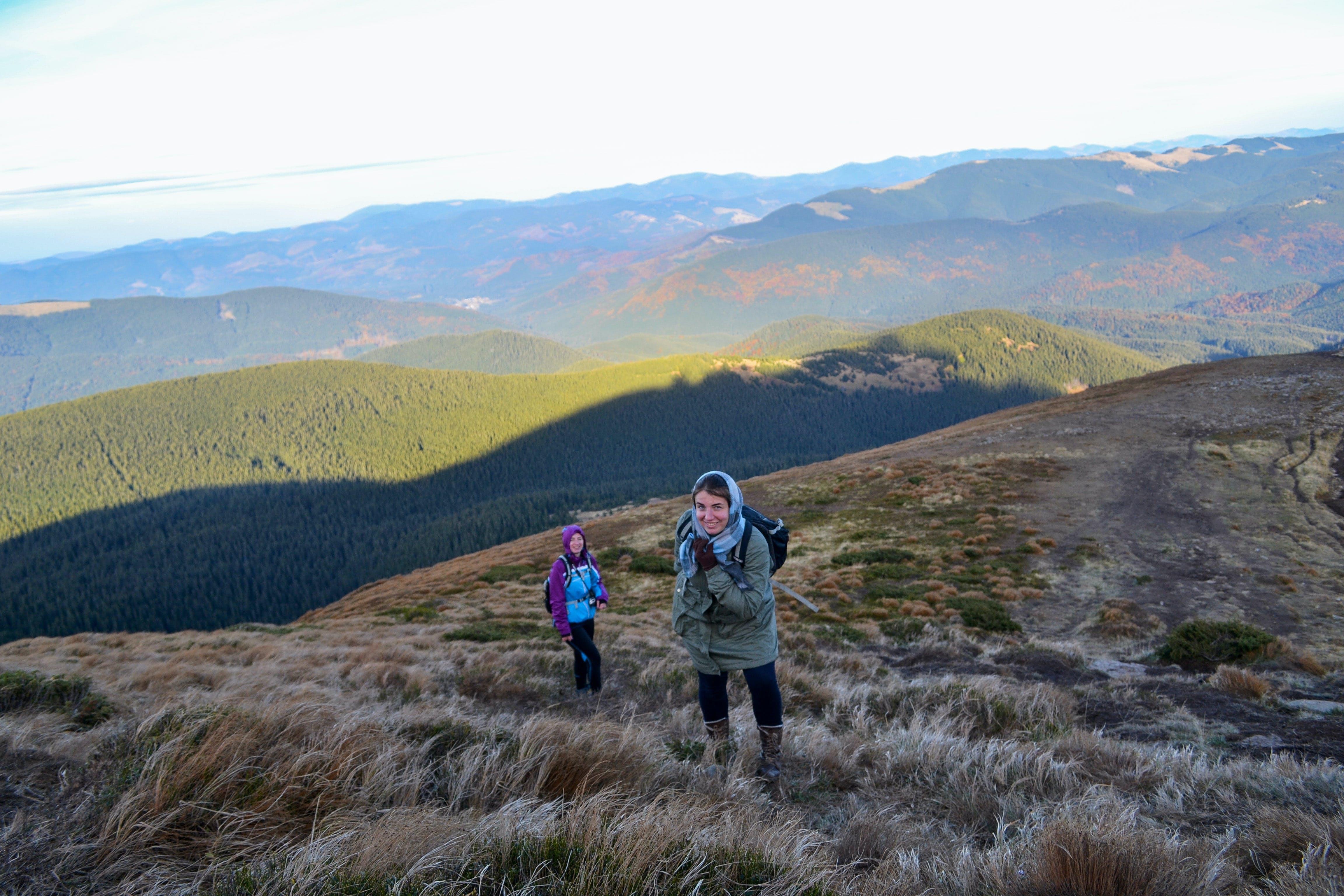 Two Women Trekking Up a Mountain