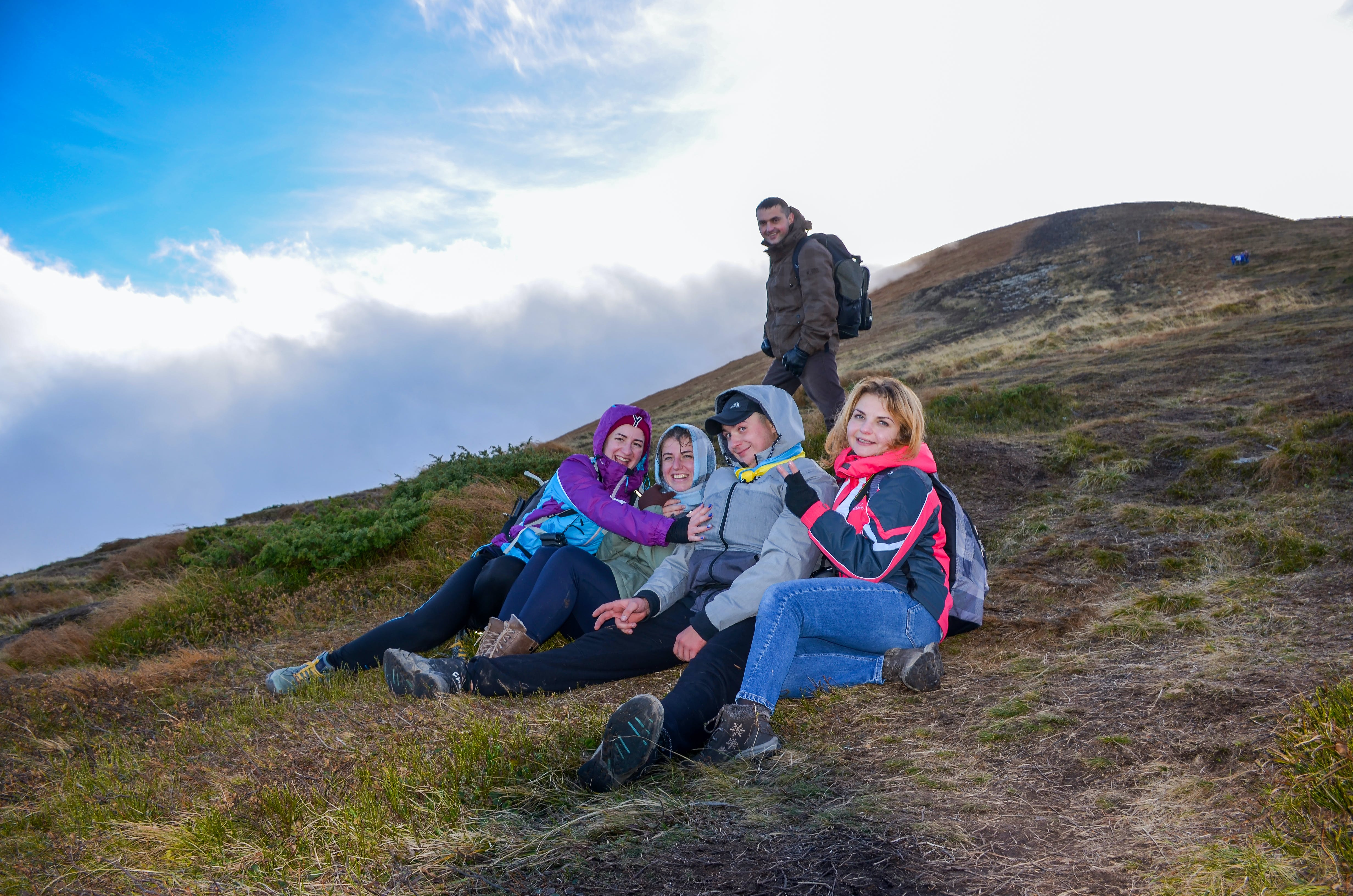 Group of People Hiking Mountain