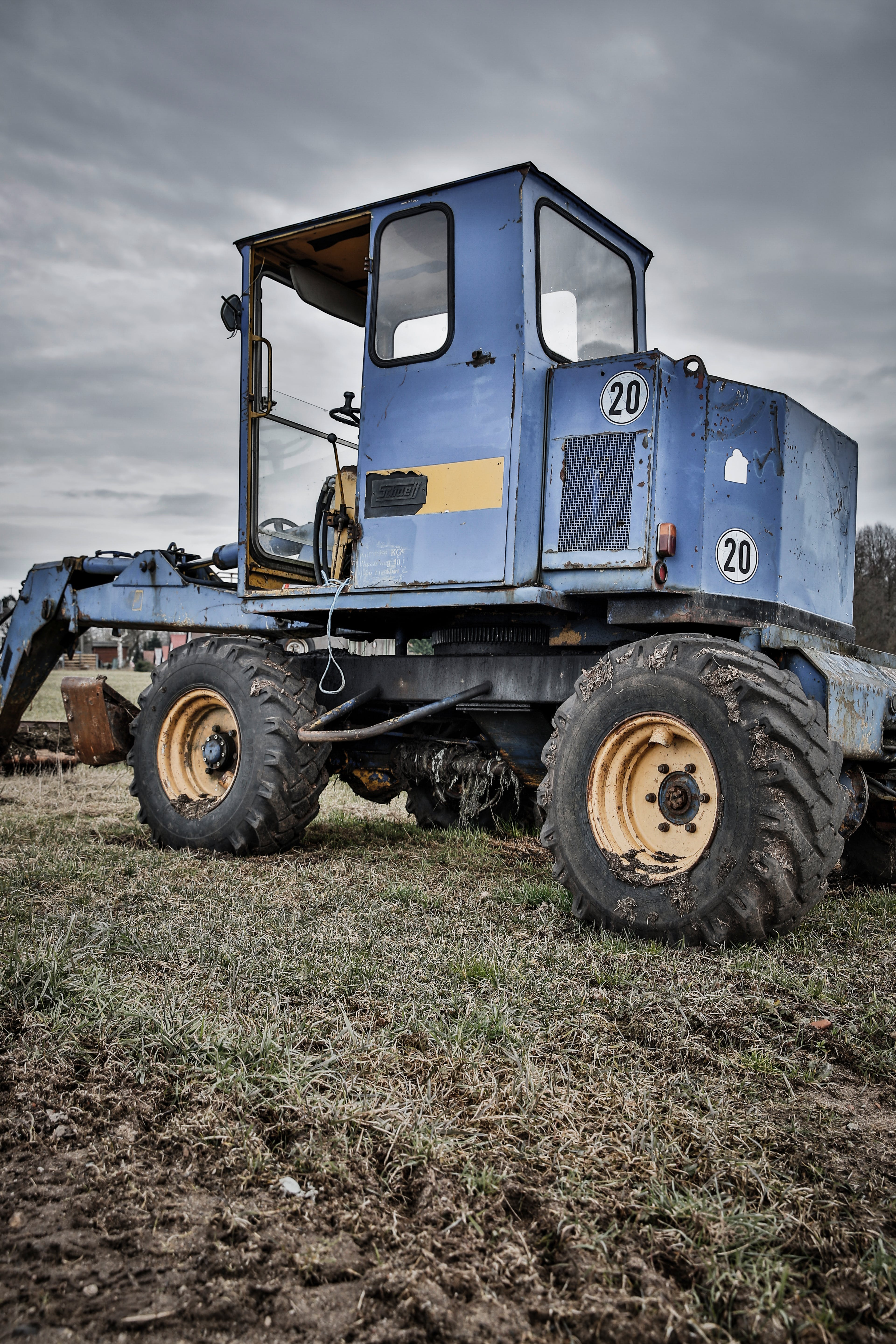 Blue and Black Tractor in Green Grass