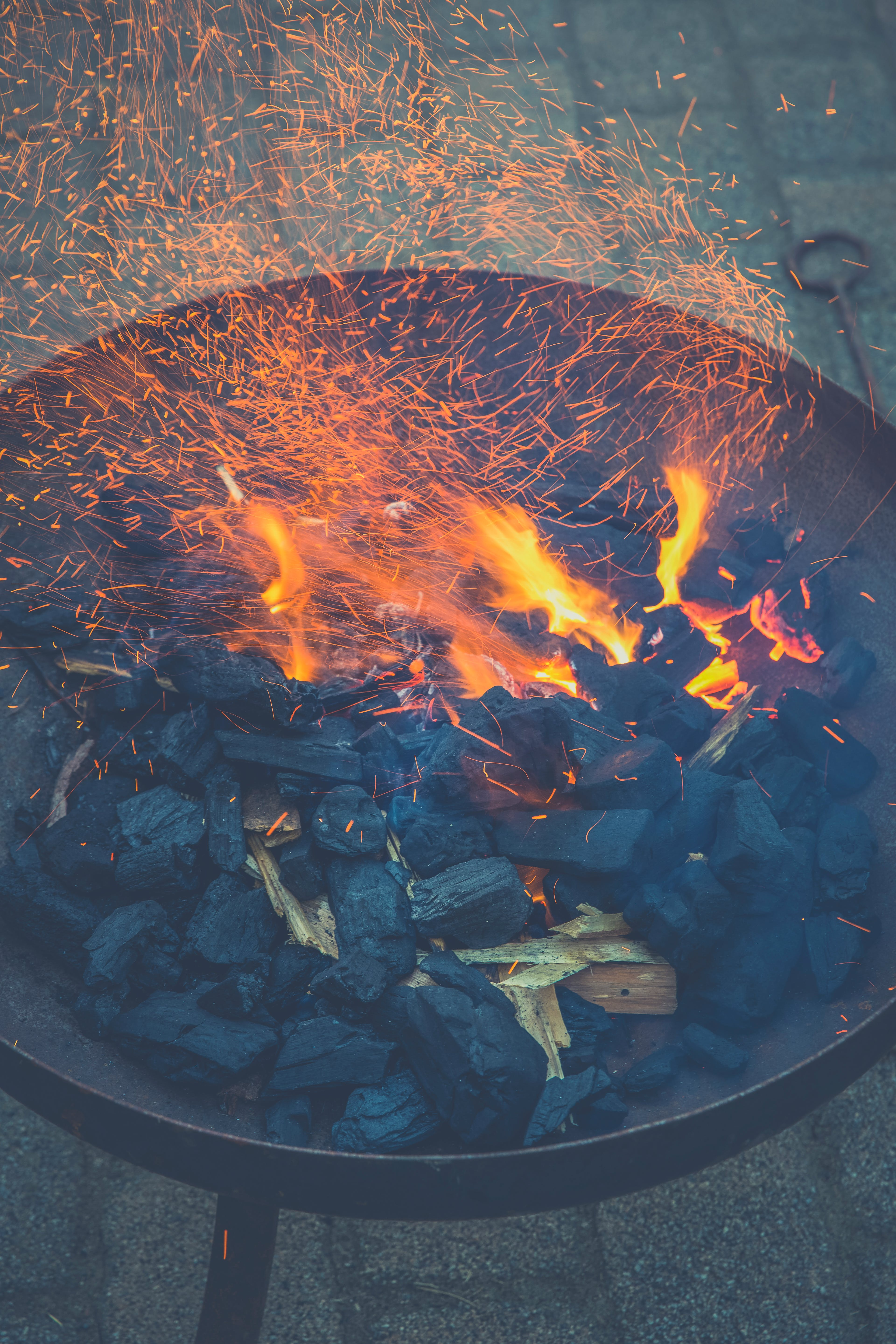 Black Charcoal With Fire on Black Round Steel Bowl
