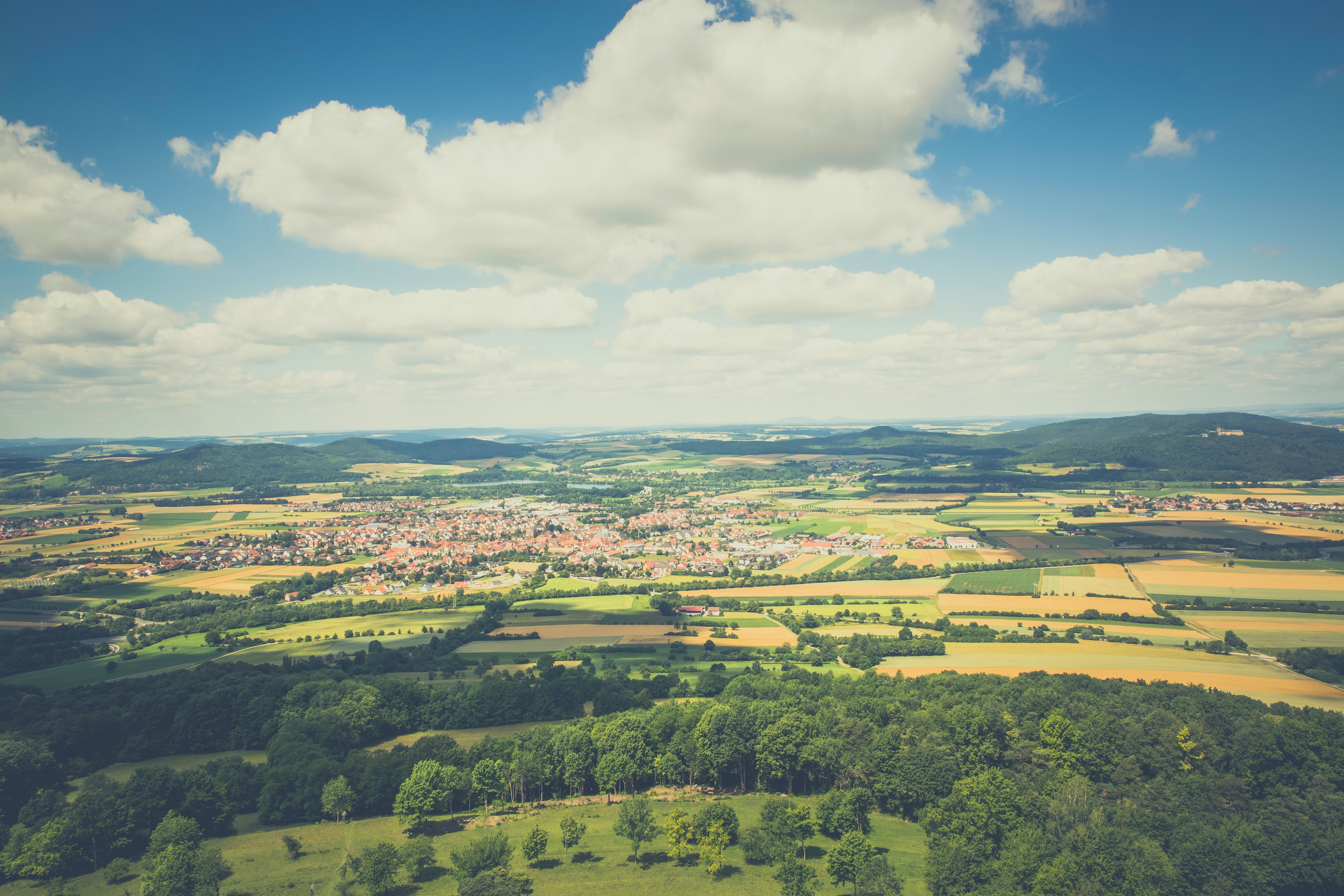 Aerial Photography of Green Fields Under Blue Sky and White Clouds during Daytime
