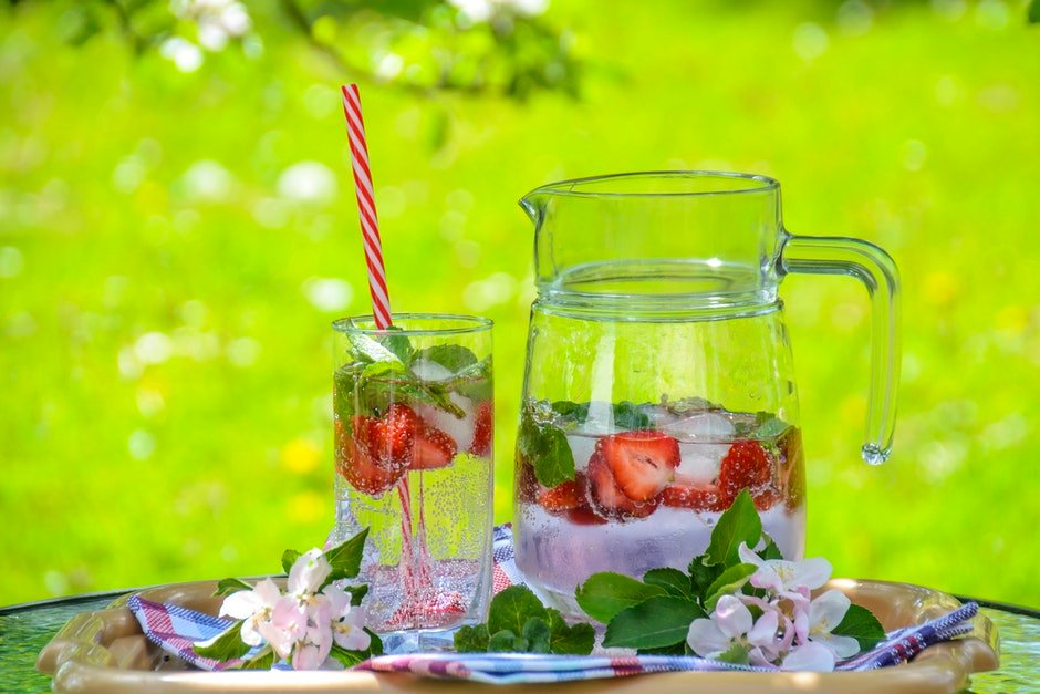Clear Glass Pitcher With Water and Strawberry