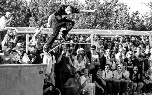 Grayscale Photography of Man Doing Ollie