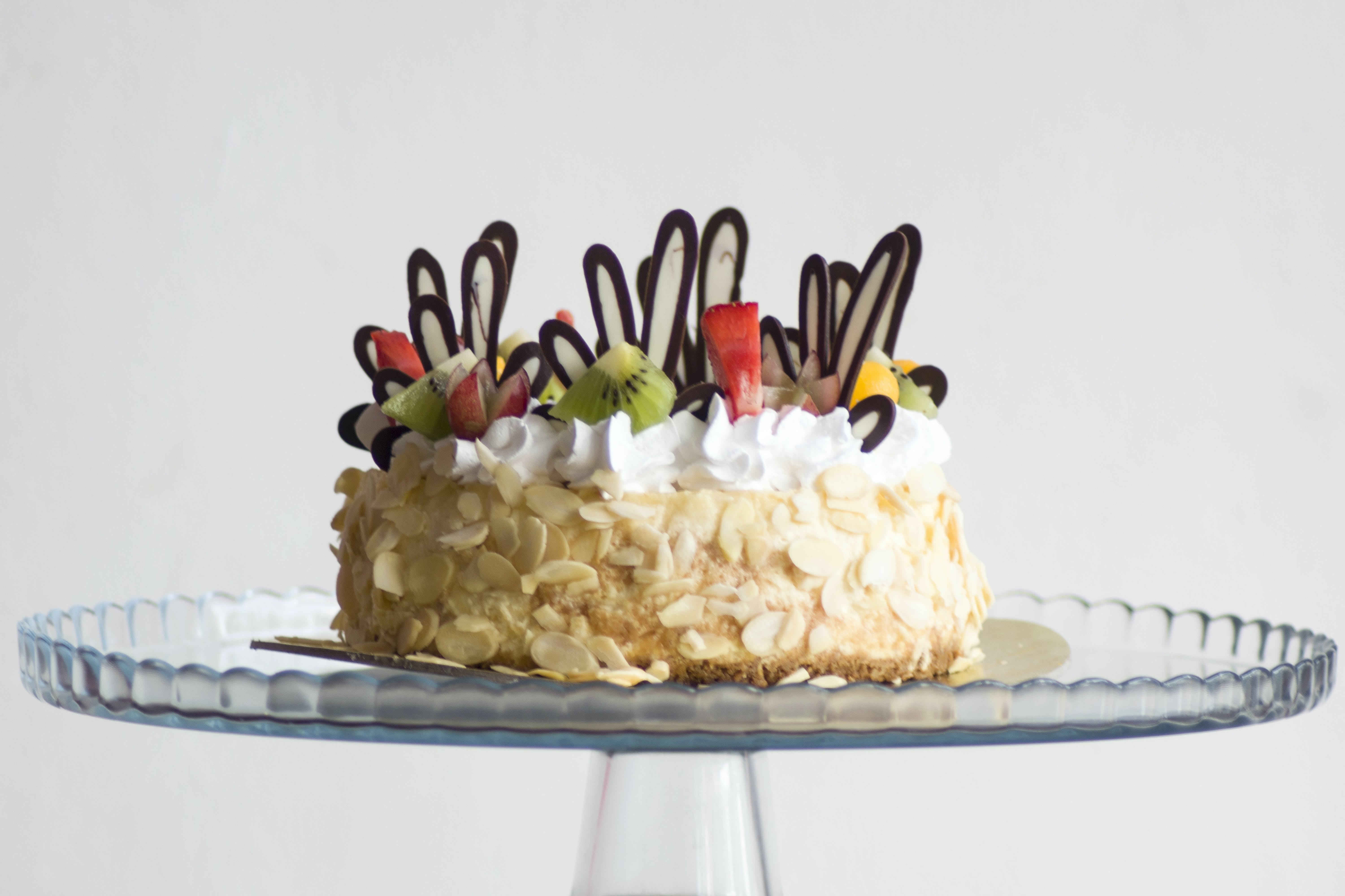 Photo of Brown and White Icing Covered Cake With Kiwi