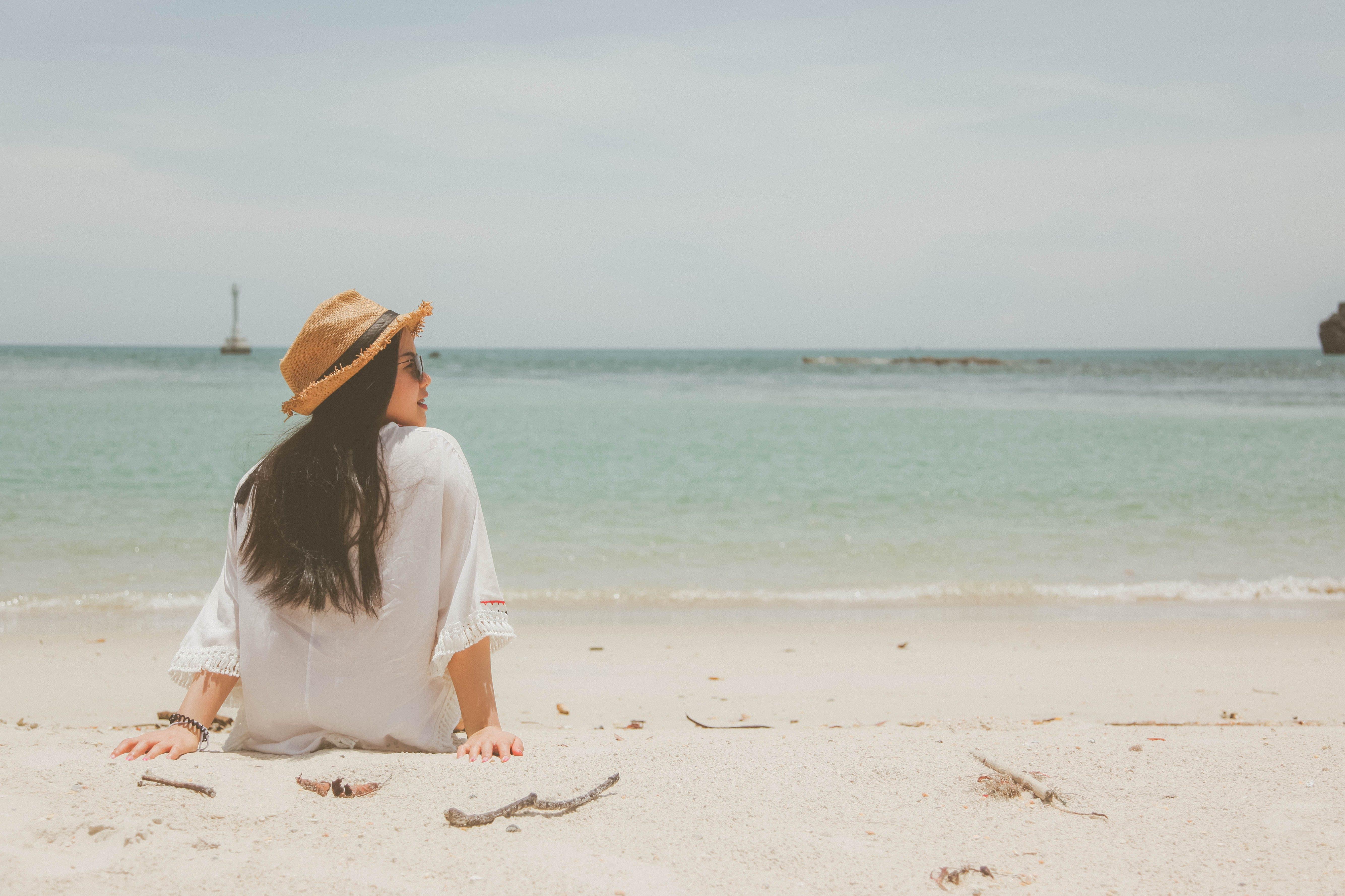 Woman Wearing White Dress on Seaside at Daytime