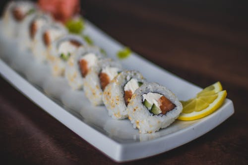 Closeup Photo of Sushi on Ceramic Plate