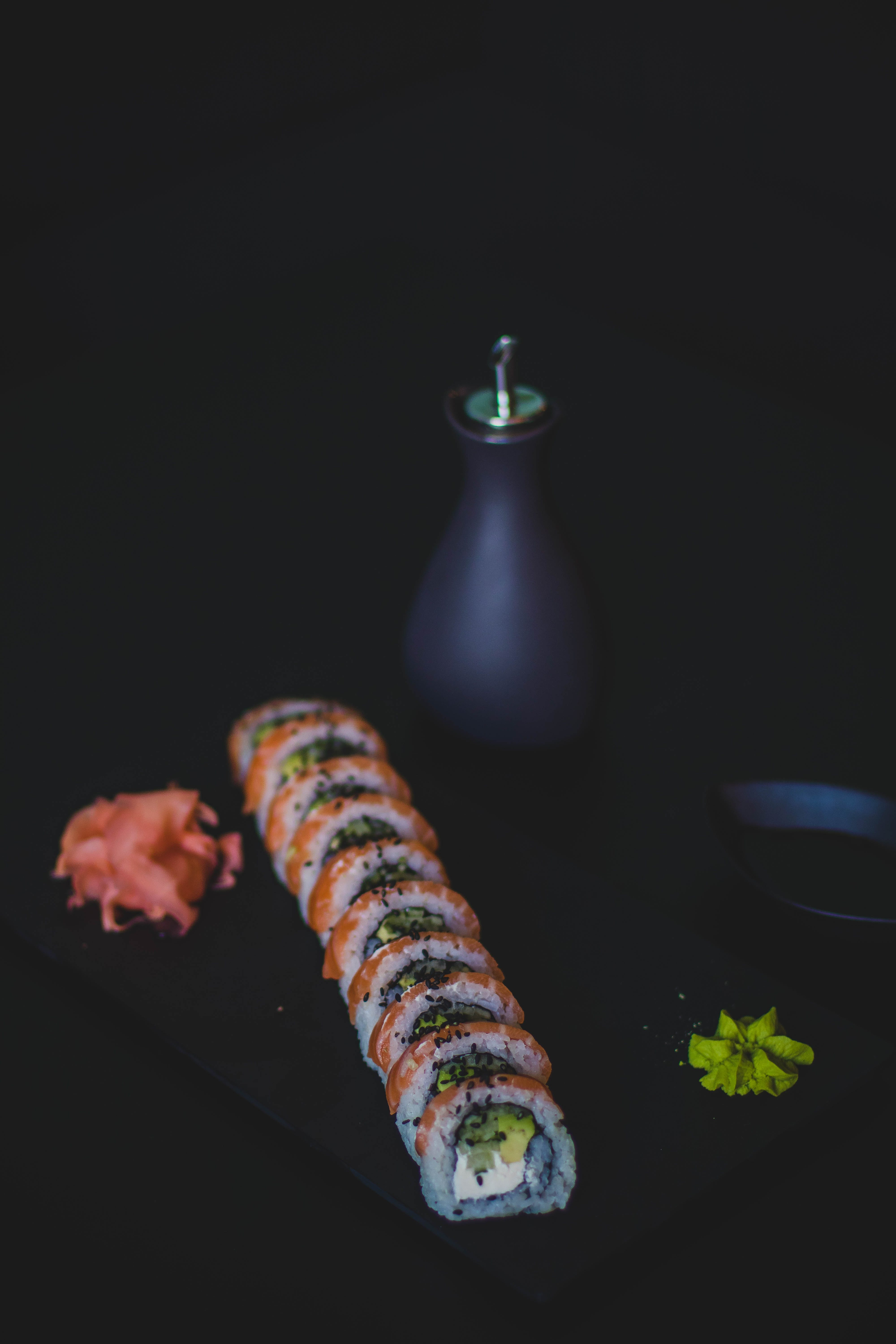 Sushi and Oil Bottle on Top of Table