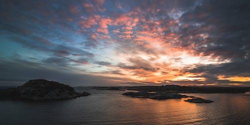 Foto d'estoc gratuïta de aigua, alba, brillant, capvespre