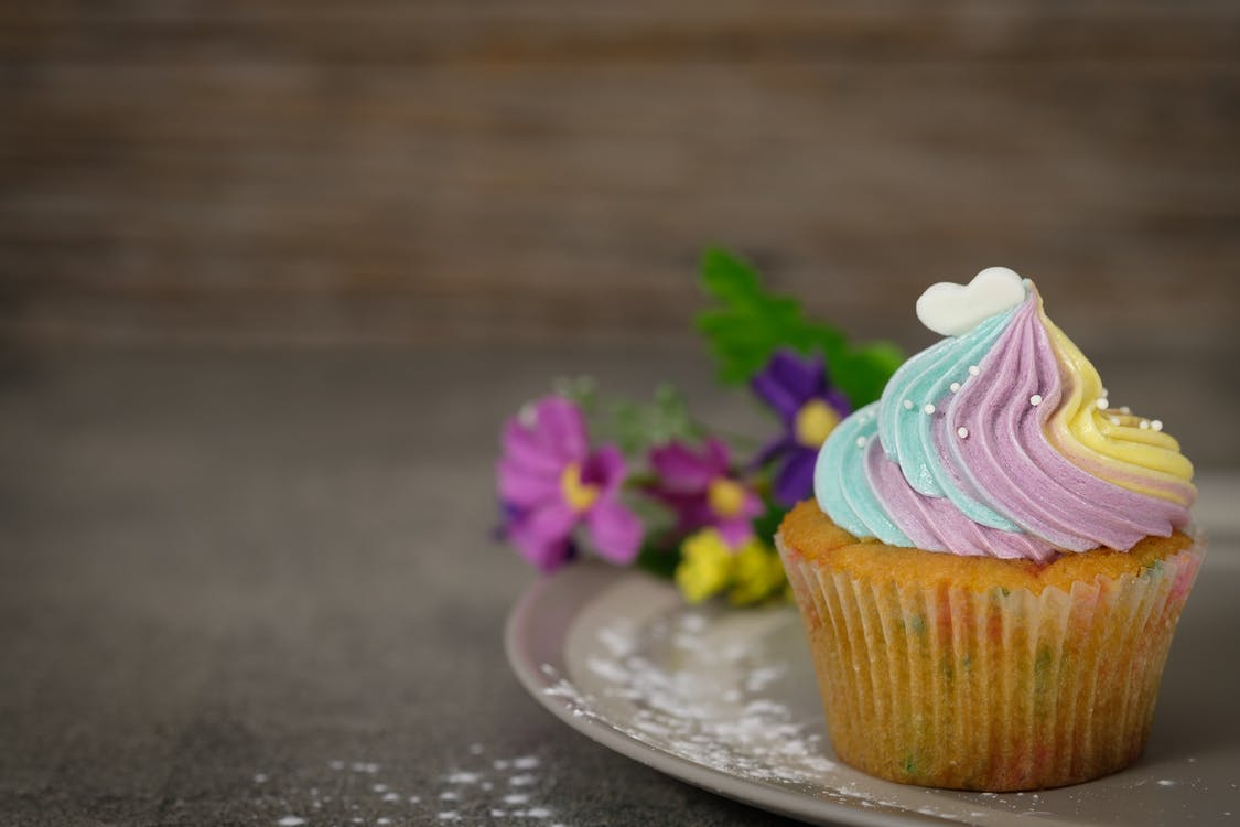 Close Up Photography of Cupcake on Gray Ceramic Plate