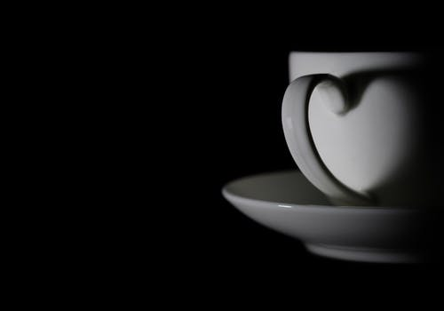 Grayscale Photography of Cup and Saucer