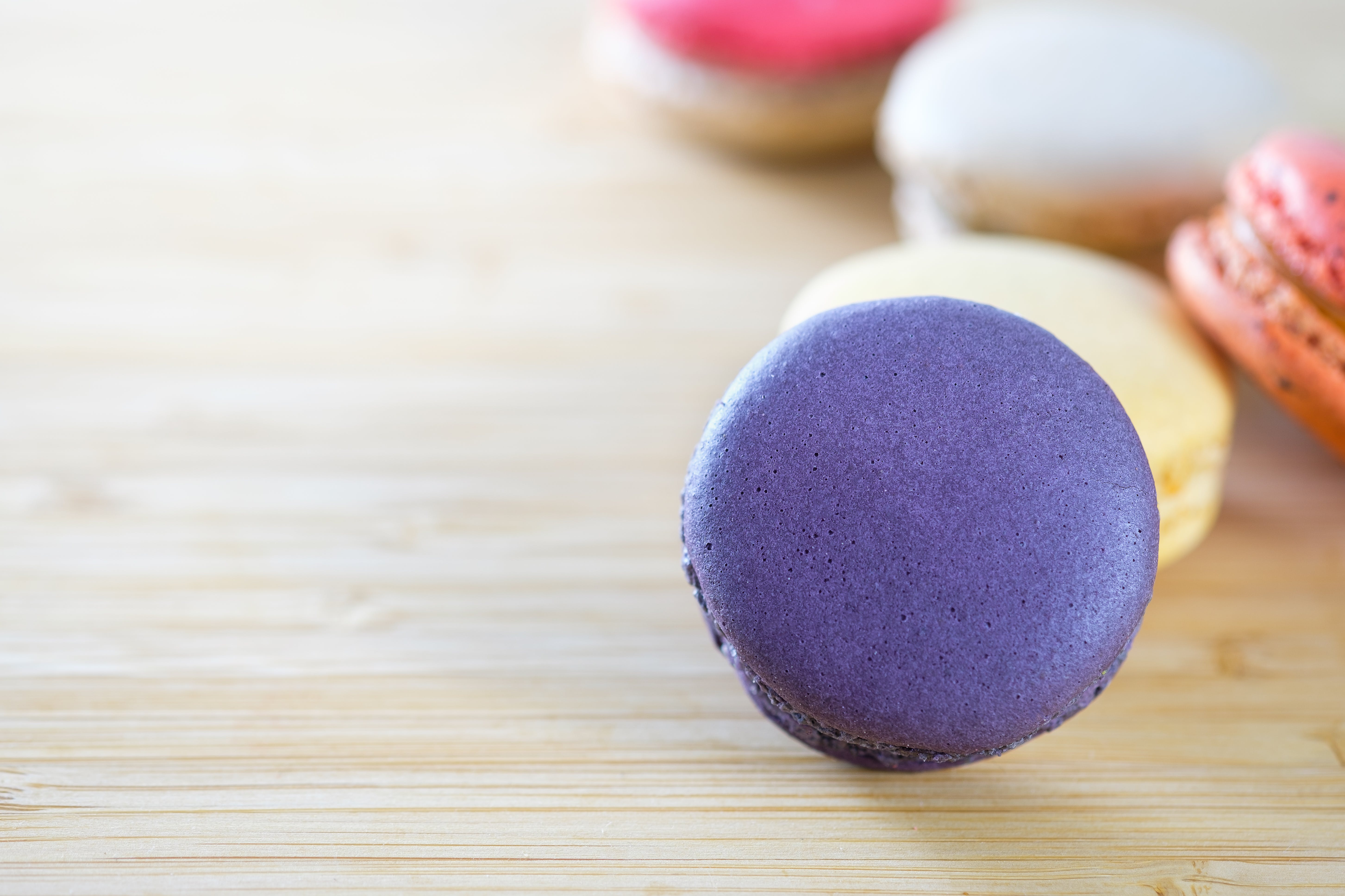 Photo of Macarons on Brown Wooden Surface