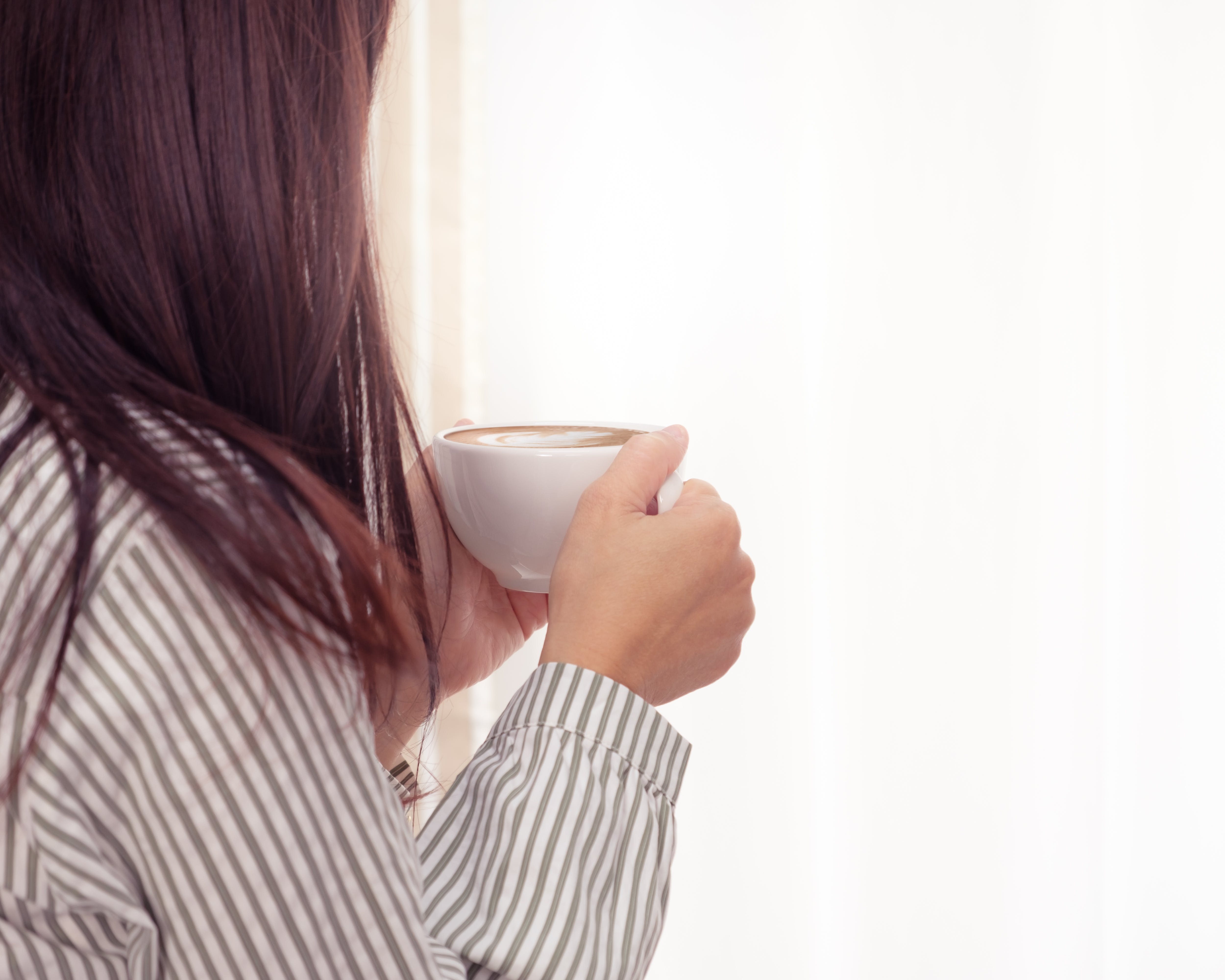 Photo of Woman Holding Cup of Coffee