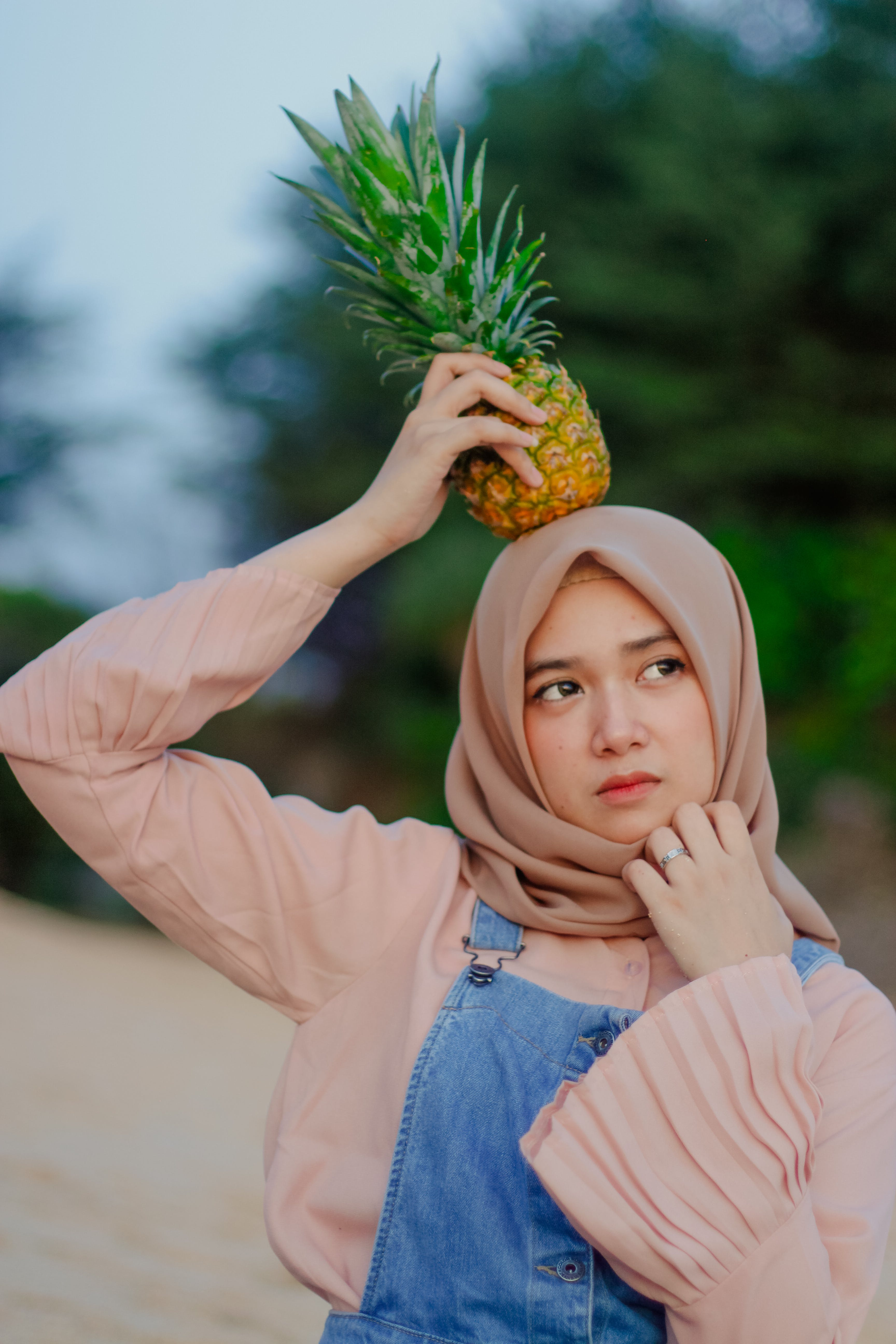 Woman Holding Pineapple on Her Head