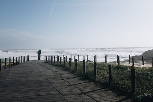 Ilmainen kuvapankkikuva tunnisteilla auringonlasku, aurinko, hiekkaranta, kevyt