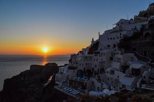 Houses Near the Ocean at Sunset