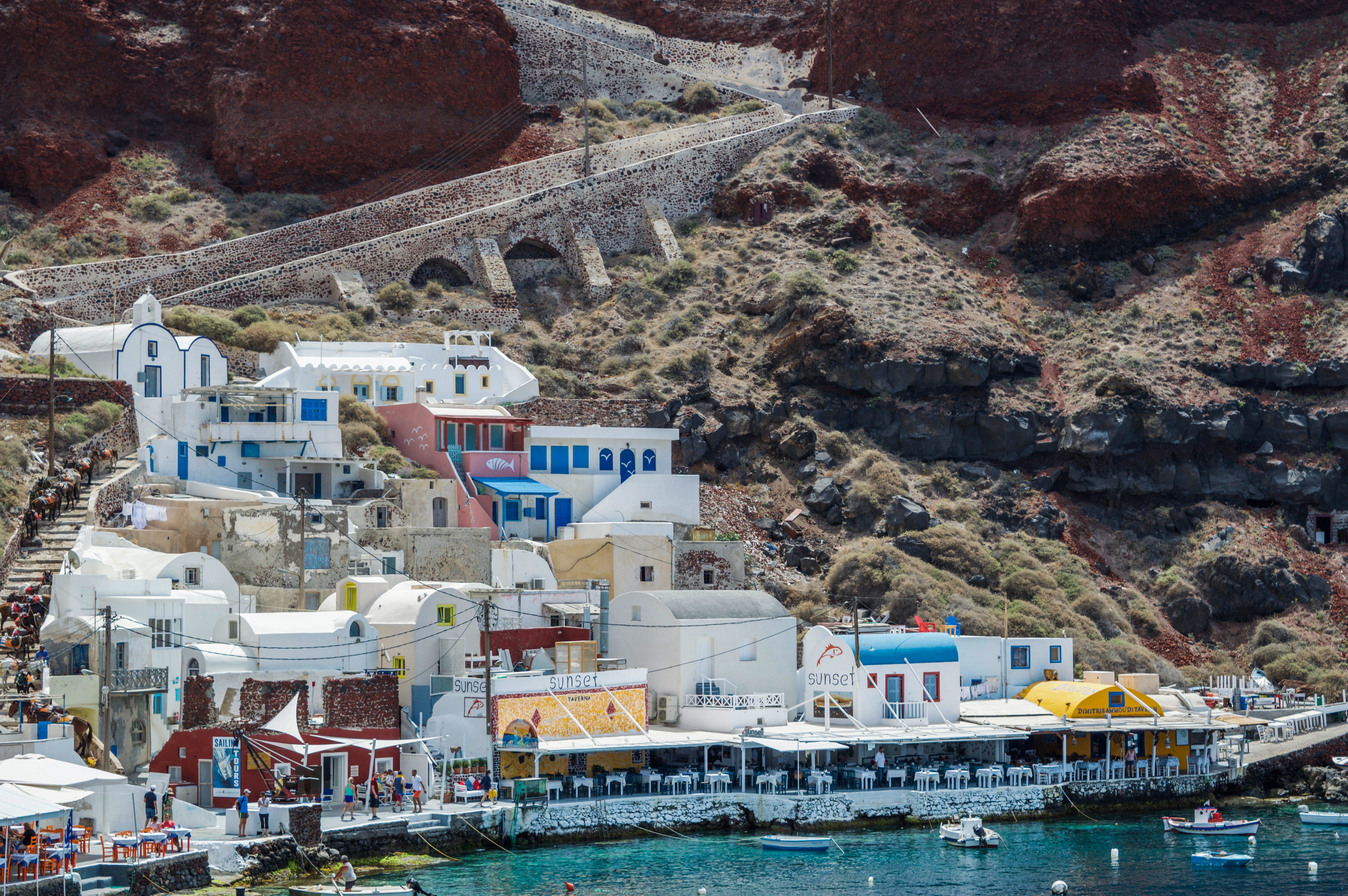 White and Blue Houses Beside Body of Water
