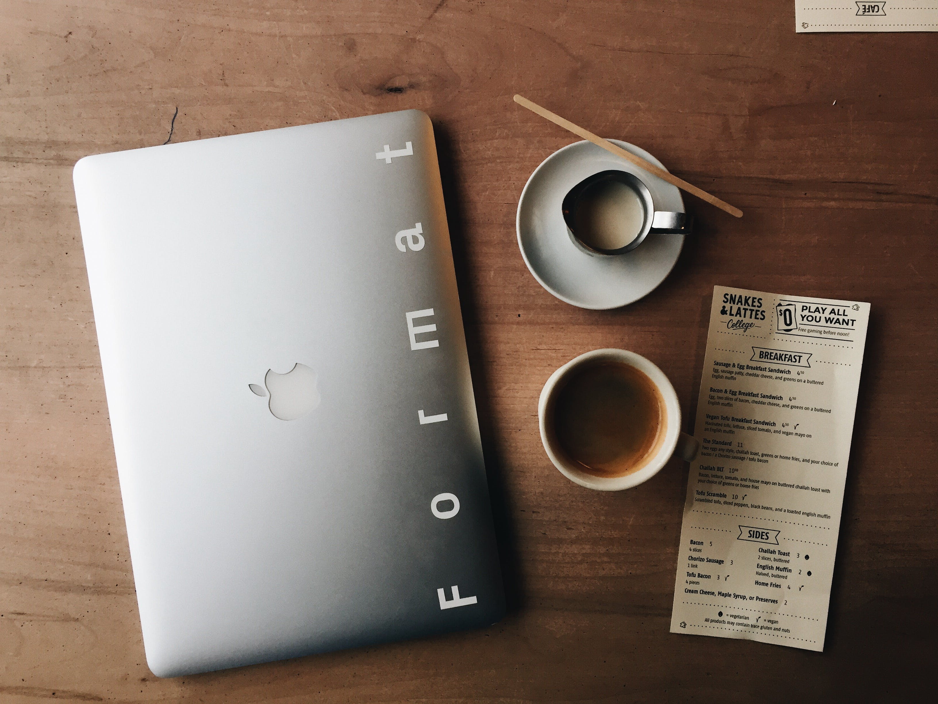 Photo of Macbook Near Cup and Saucer