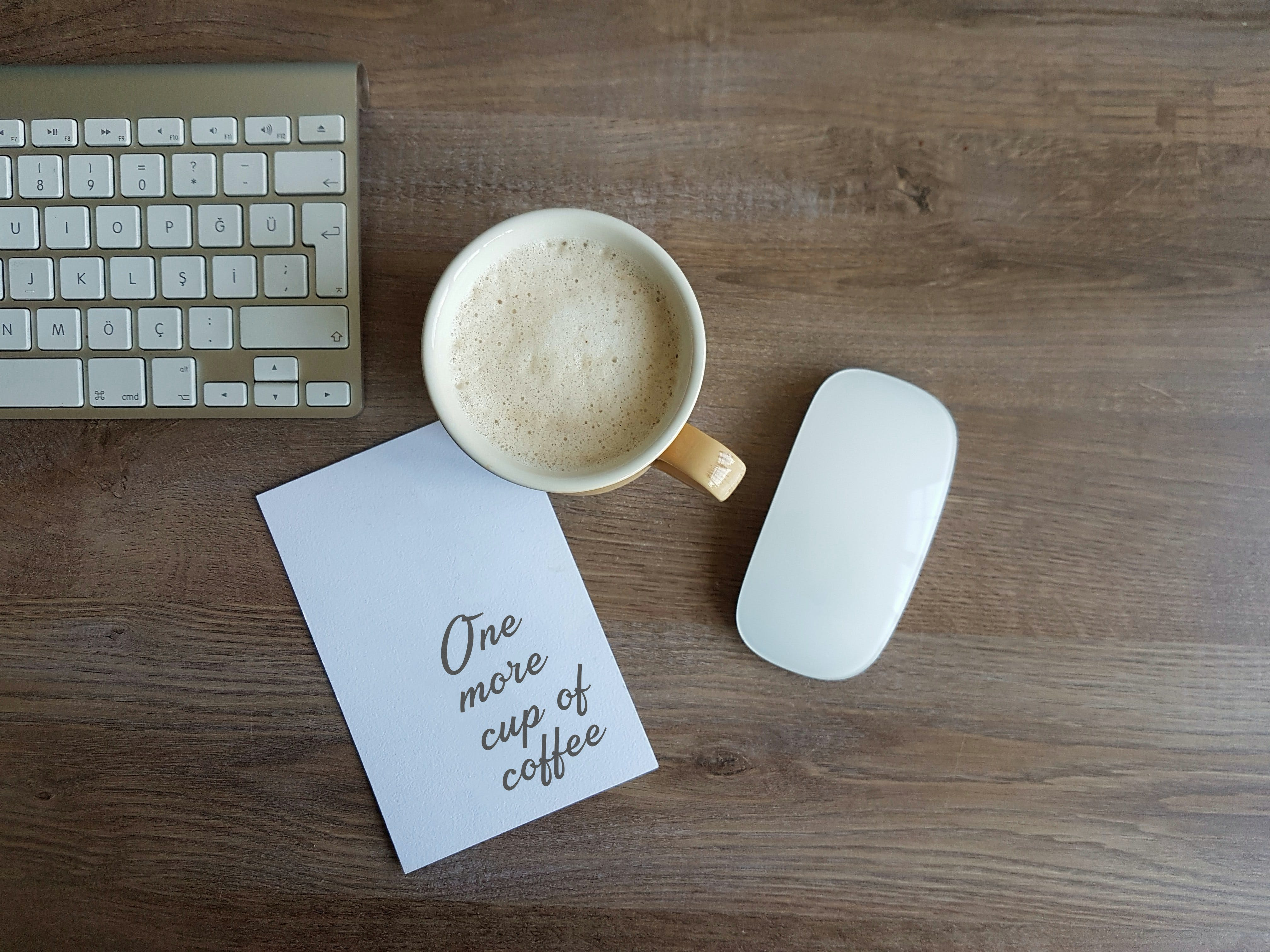 Apple Magic Mouse and White Ceramic Mug