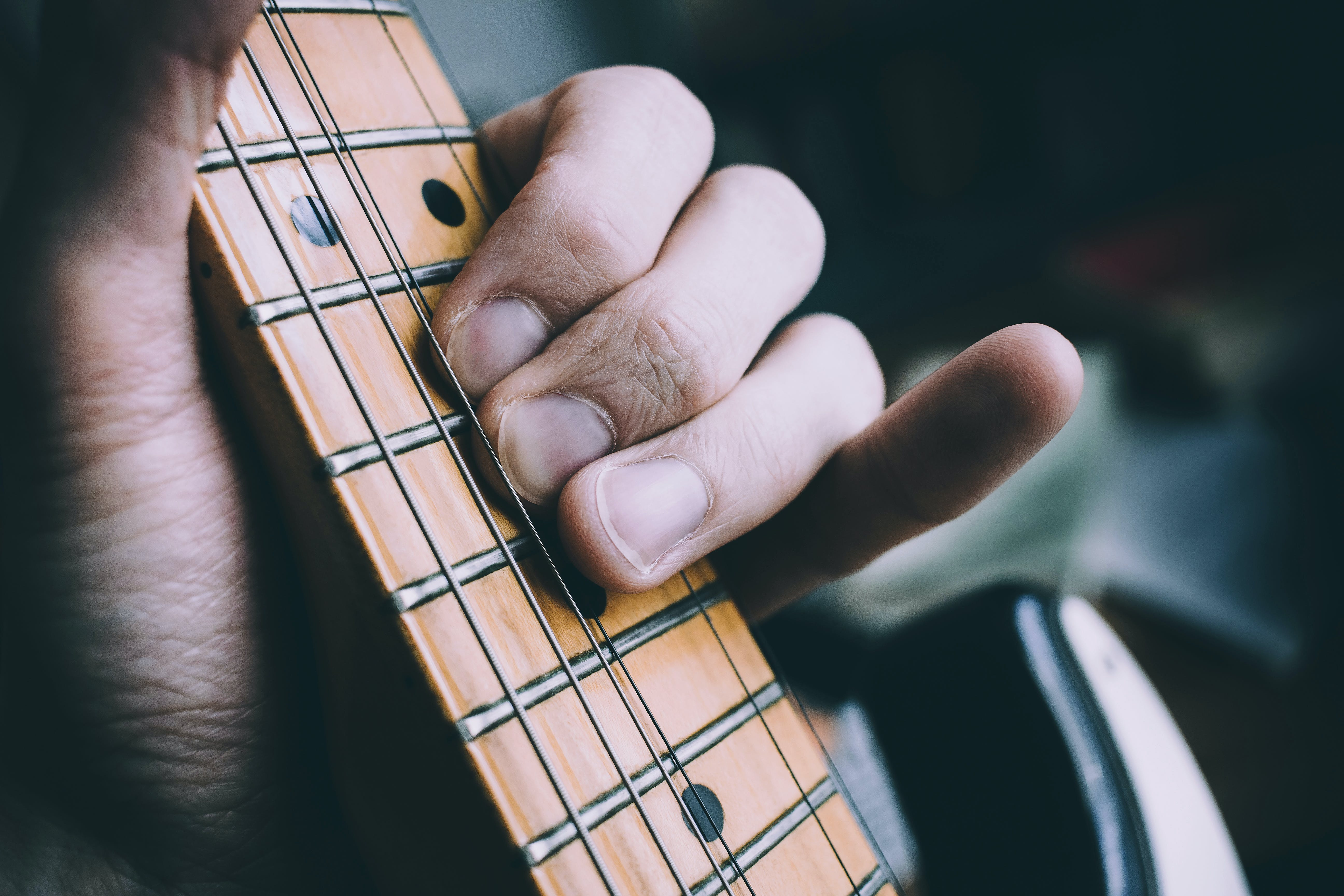 Photo of Person Playing the Guitar