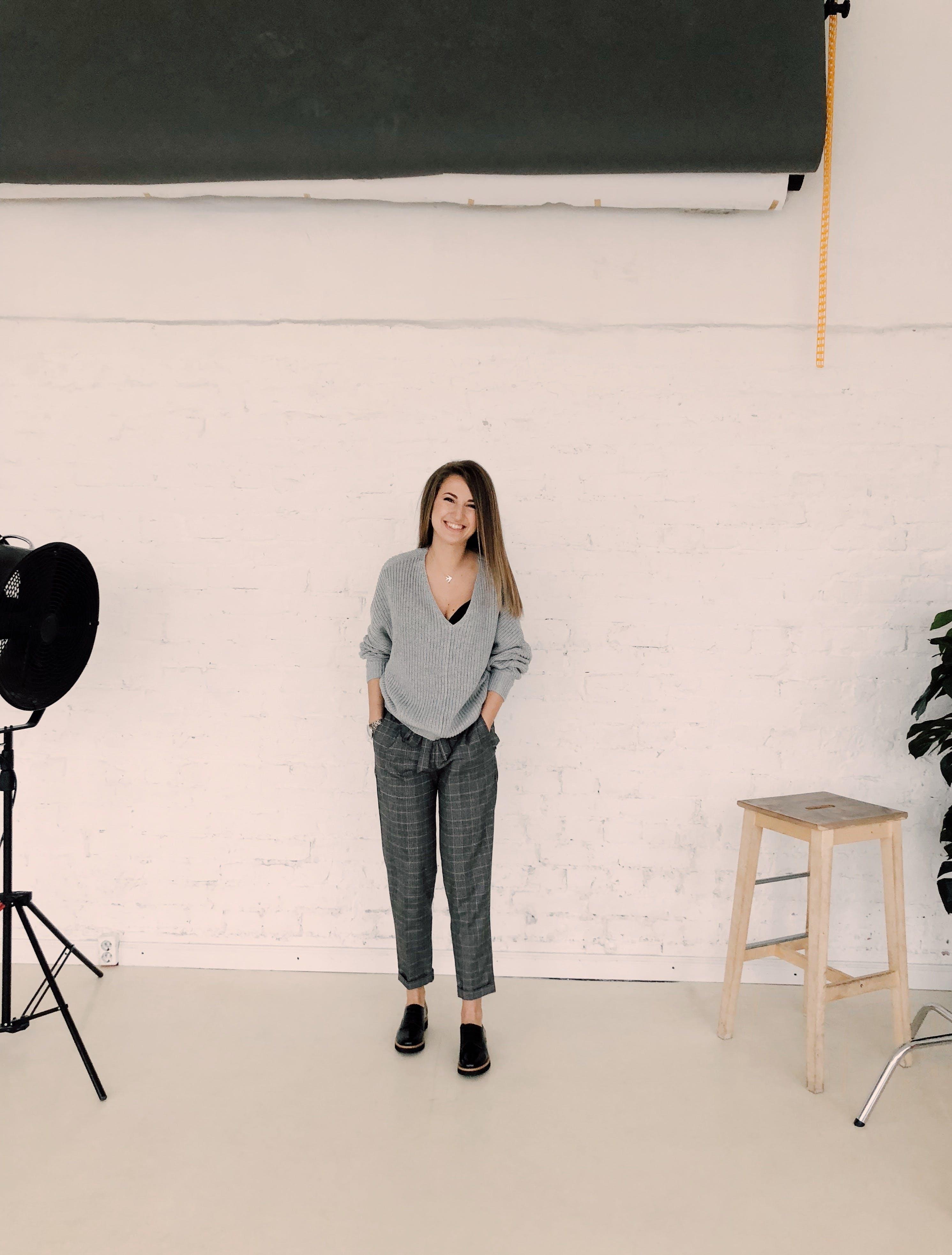 Photo of Woman Wearing Gray Sweater