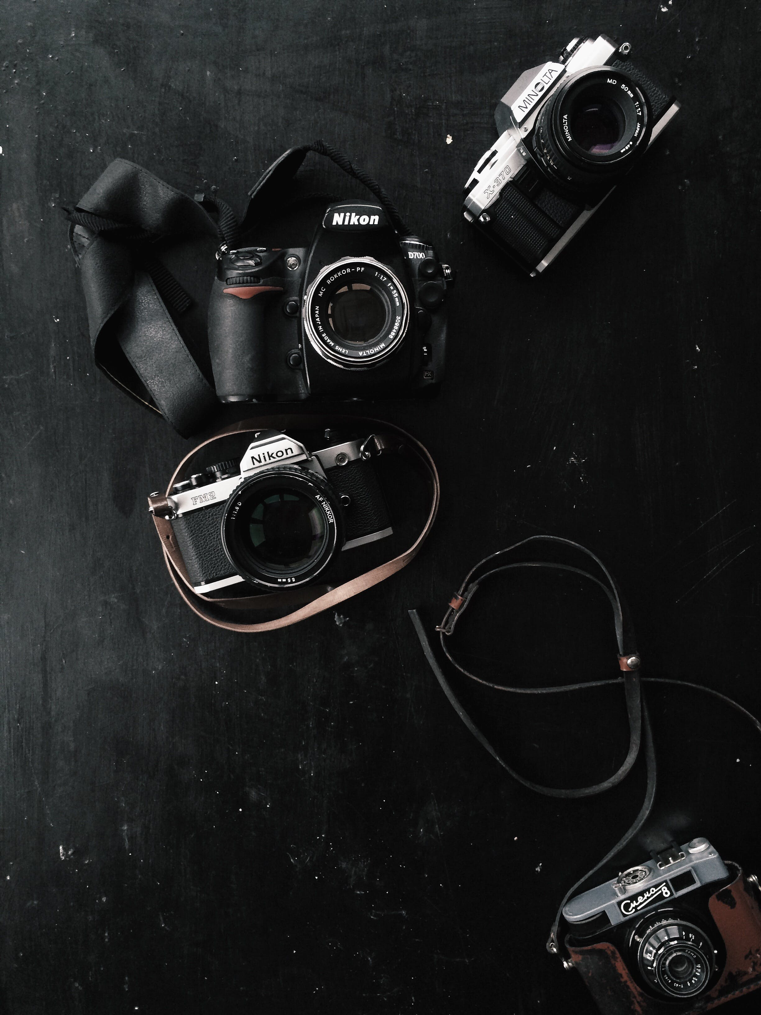 Three Black and Gray Dslr and Slr Cameras