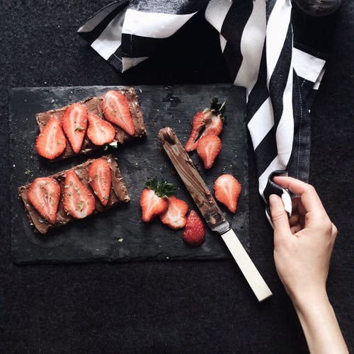 Slices Strawberries on Chopping Board
