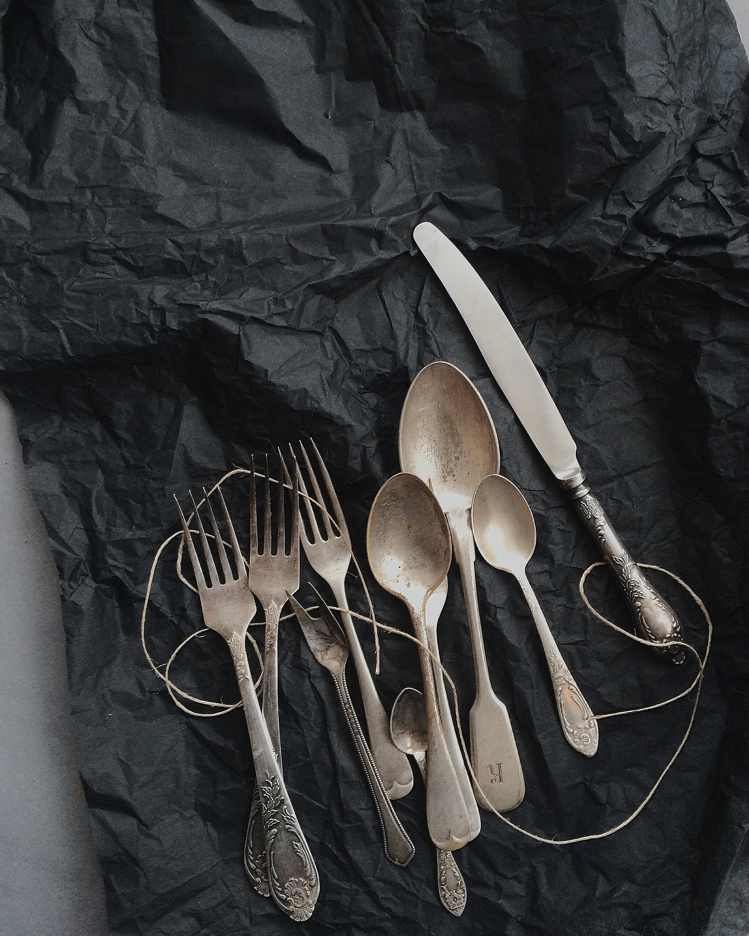 Photo of Stainless Steel Cutlery on Black Cloth