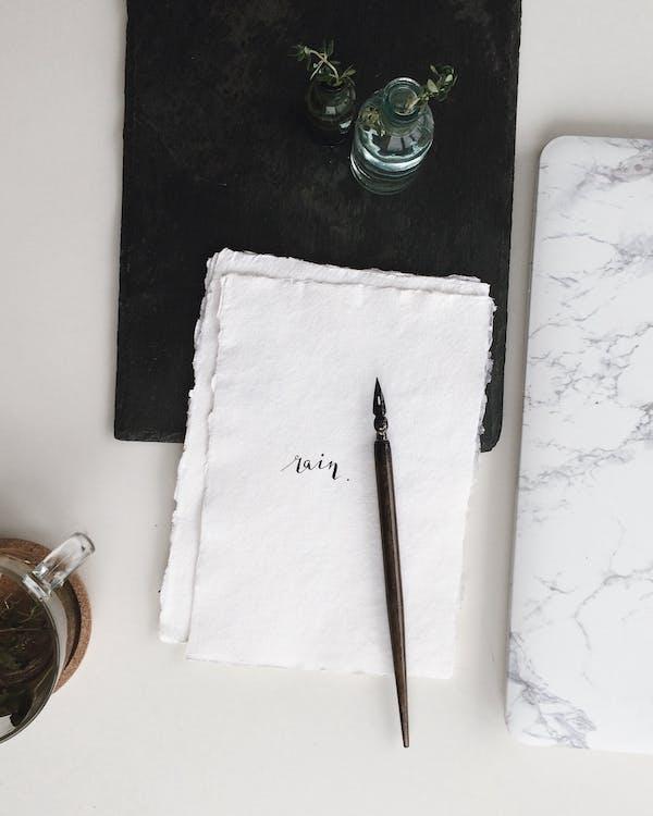 Black Fountain Pen on White Text
