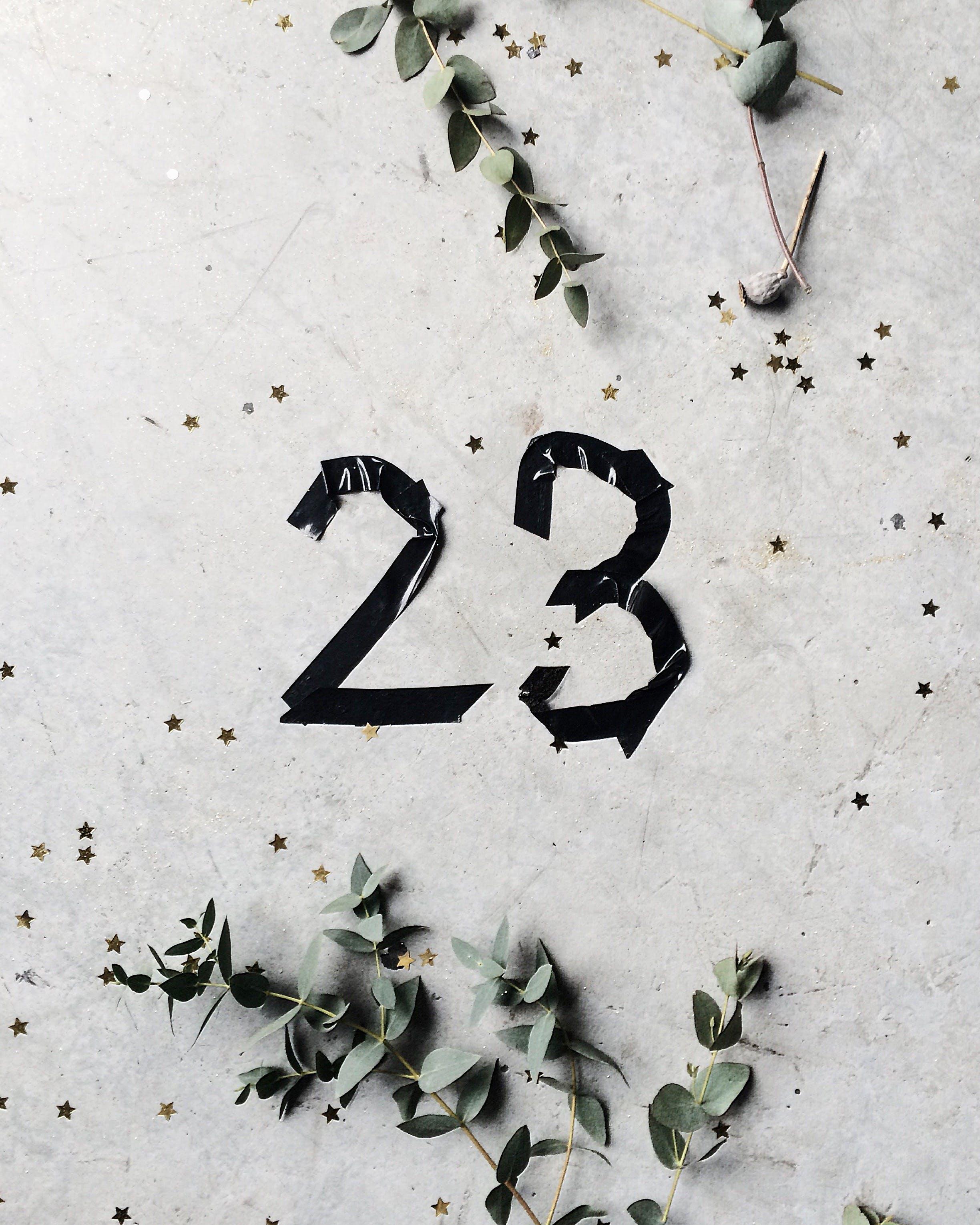White Concrete Wall Showing 23 Sticker