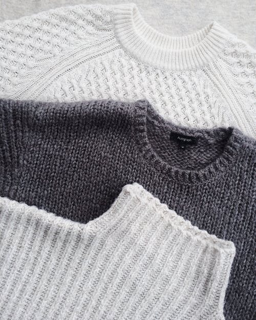 Close-up Photo of Three Sweatshirts