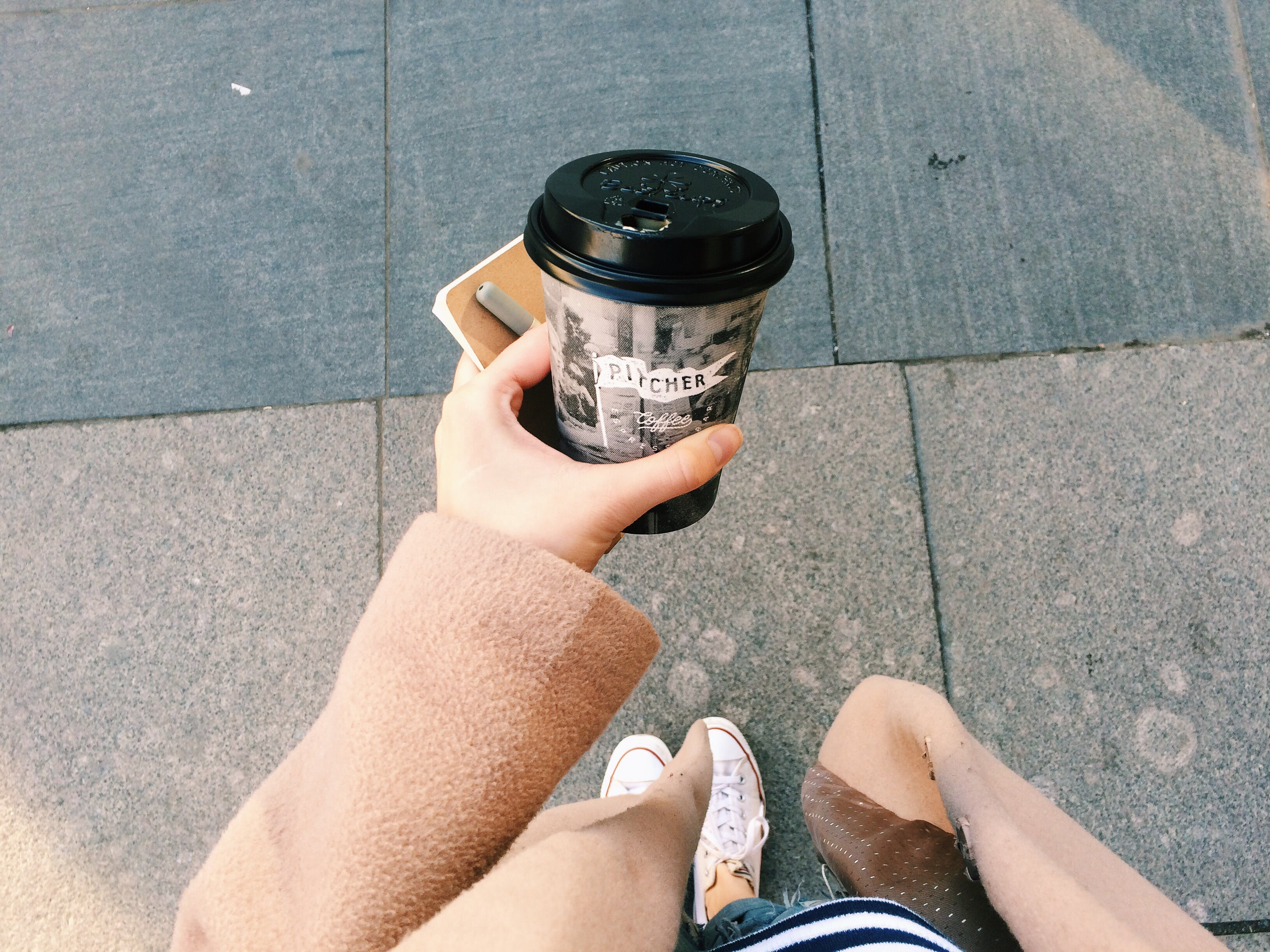 Person Holding Gray Disposable Cup