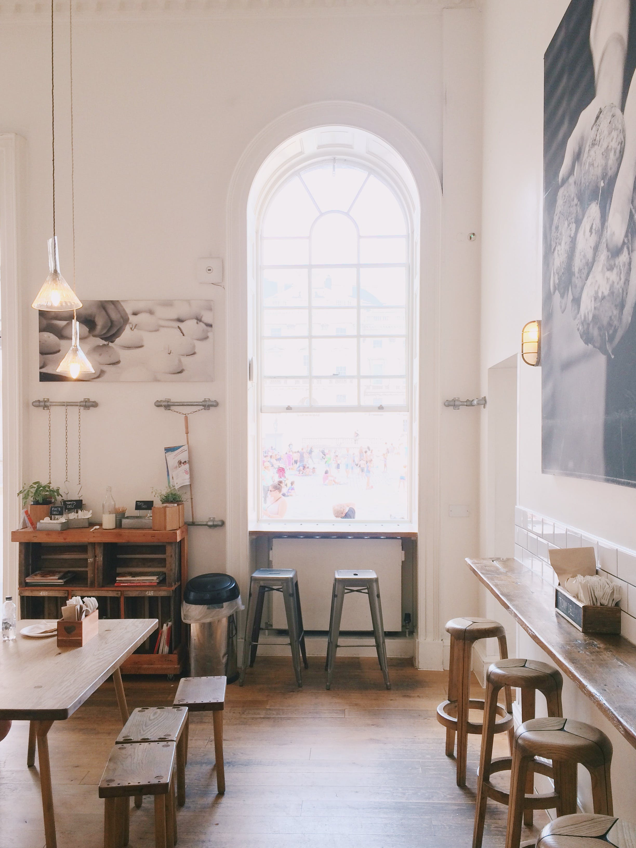 Two Grey Wooden Stools Near Window With Arc Frame