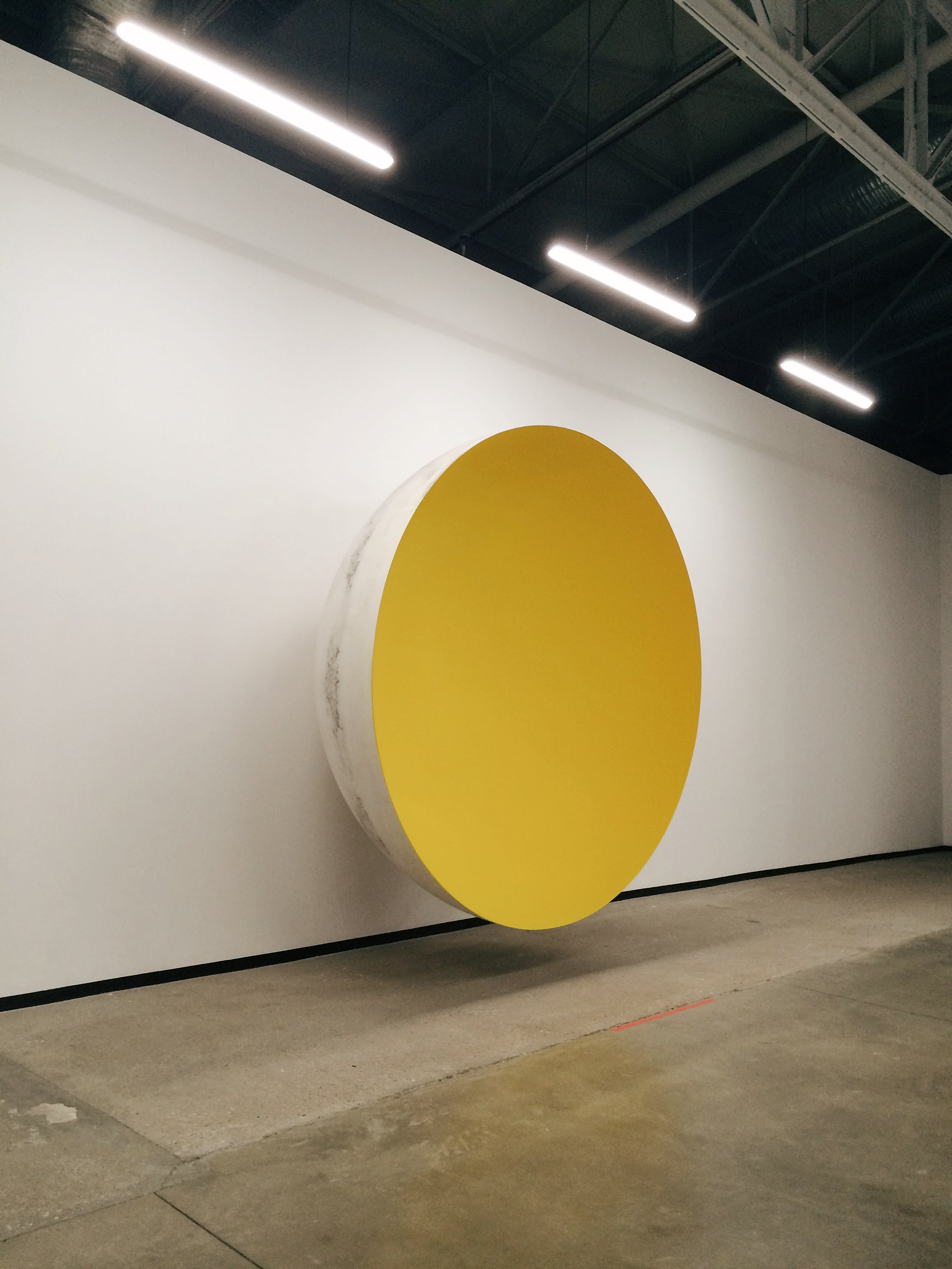 Yellow and White Bowl on Wall