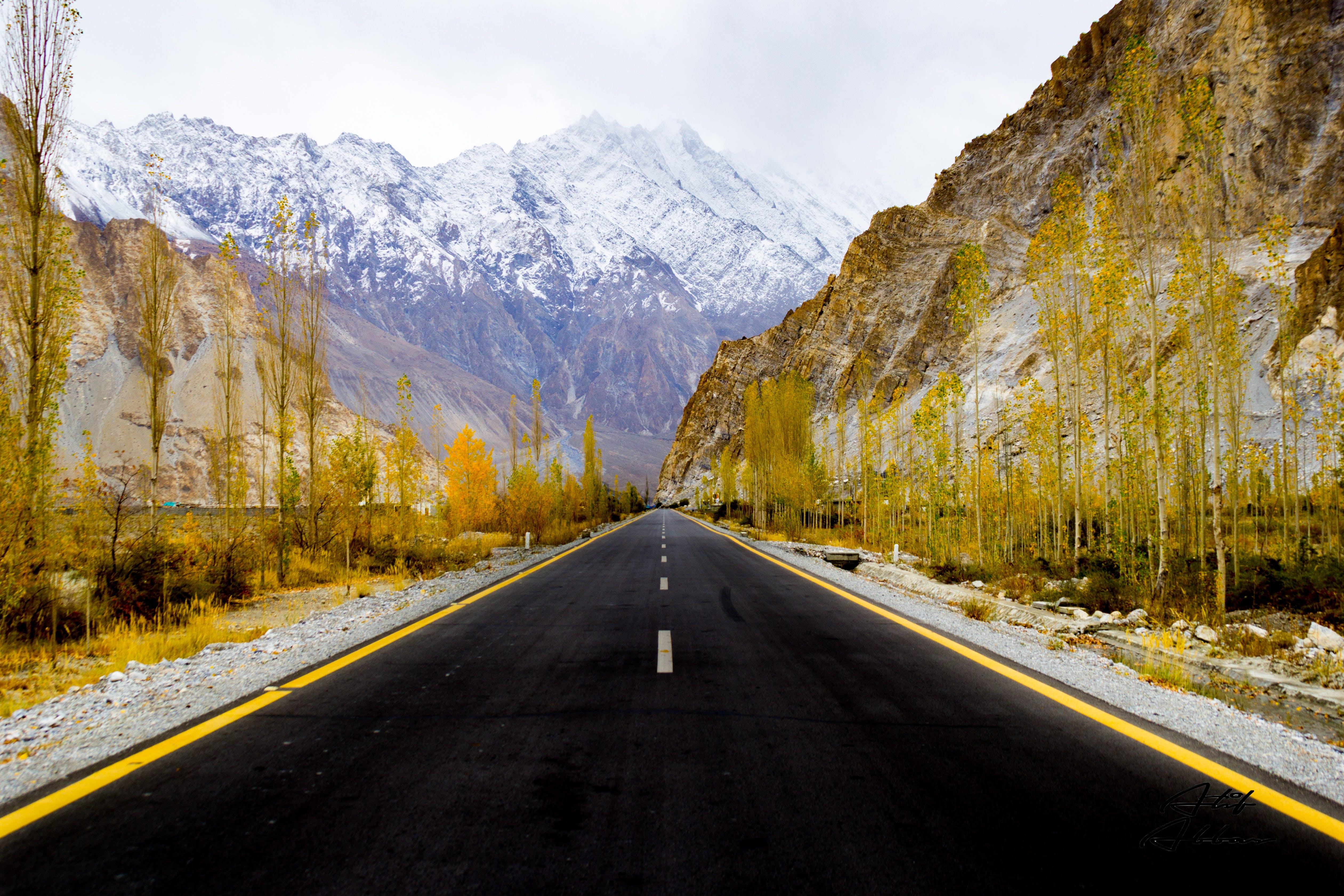 Asphalt Road Between Rock Mountains