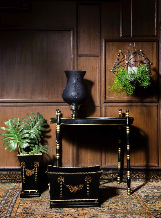 Black Wooden End Table Near Square Brown and Black Wooden Pot and Rectangular Black and Brown Wooden Trunk