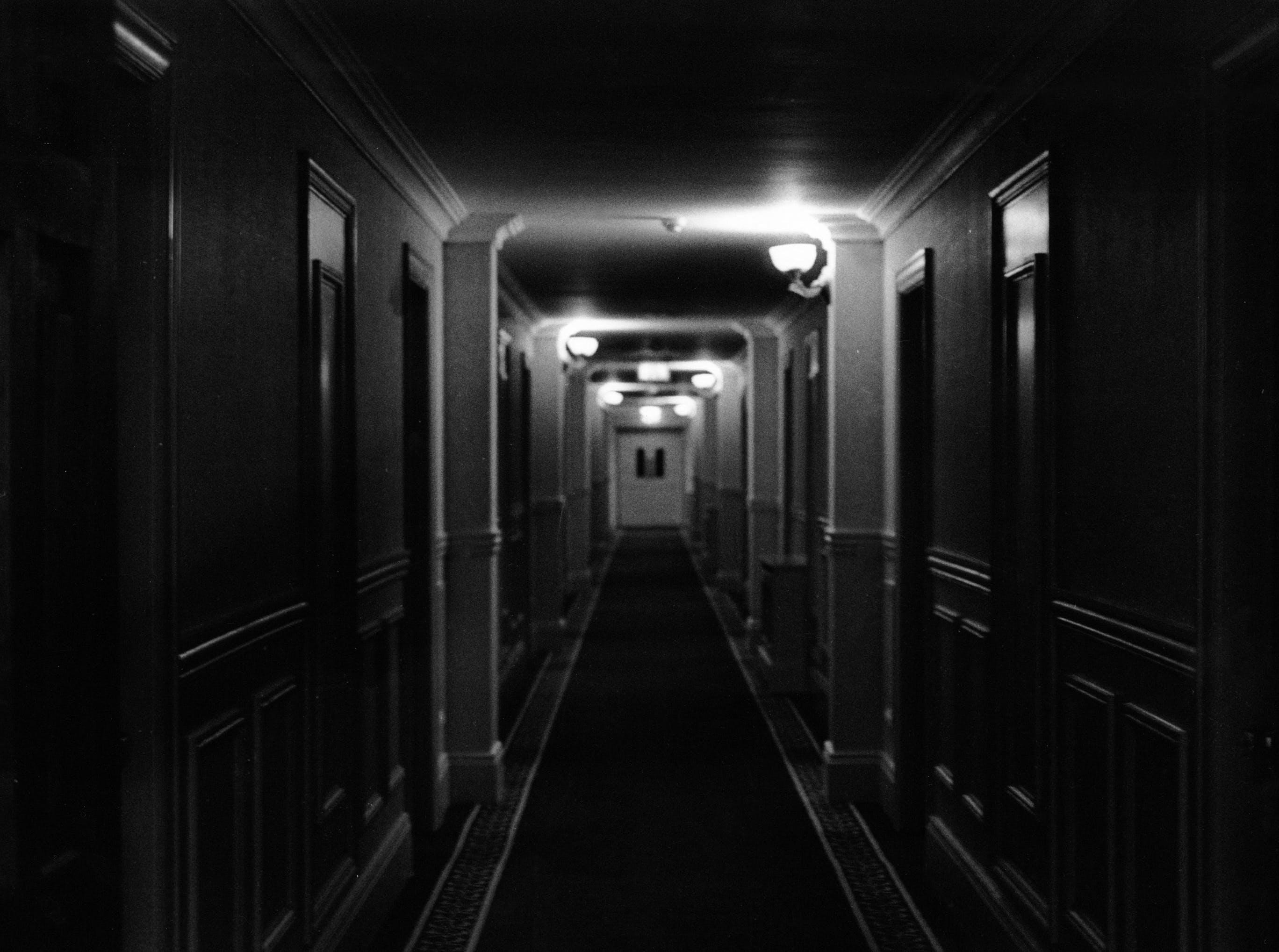Free stock photo of dark, hallway, black and white, doors