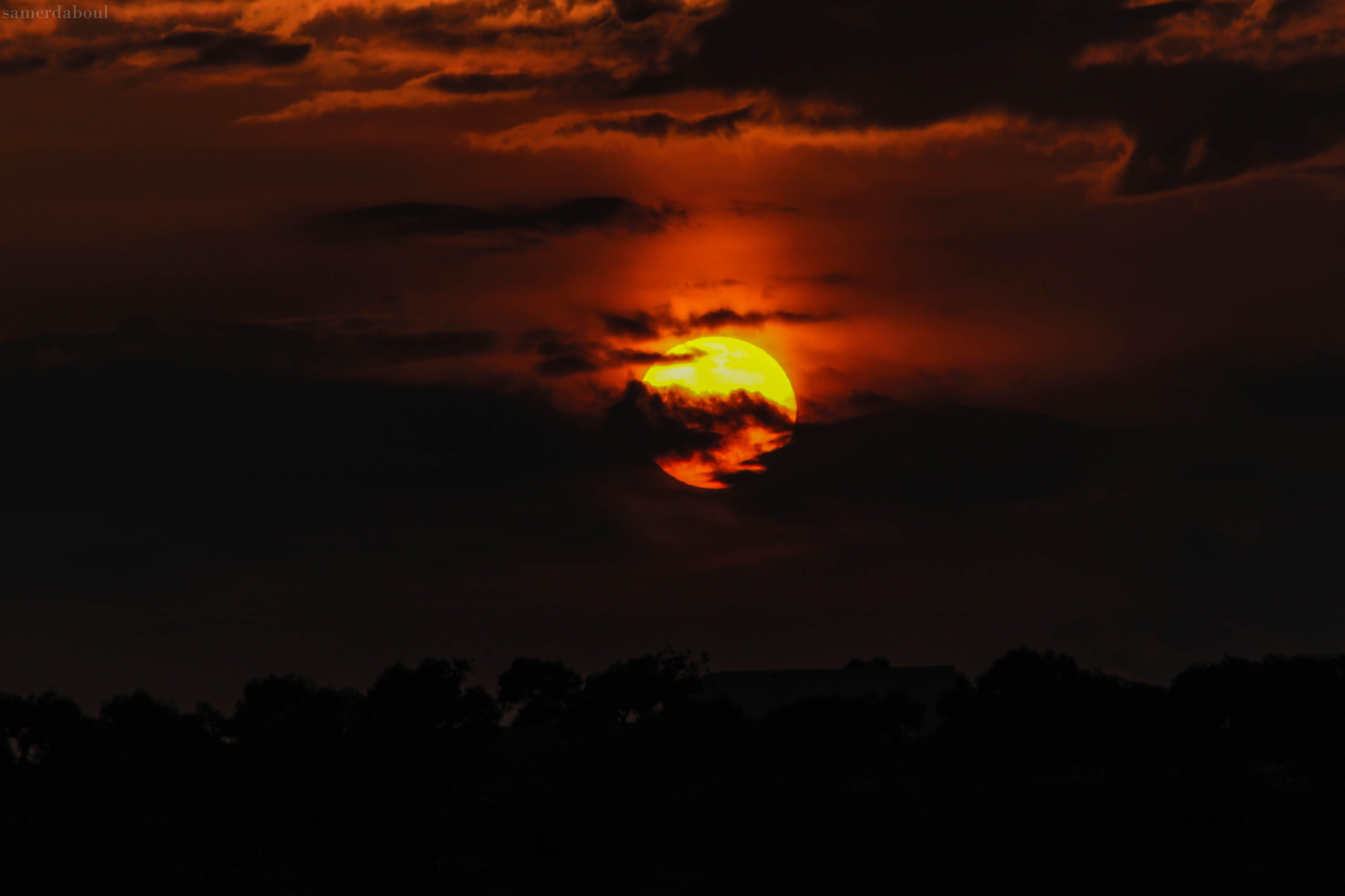 Orange Sun Hiding on Clouds