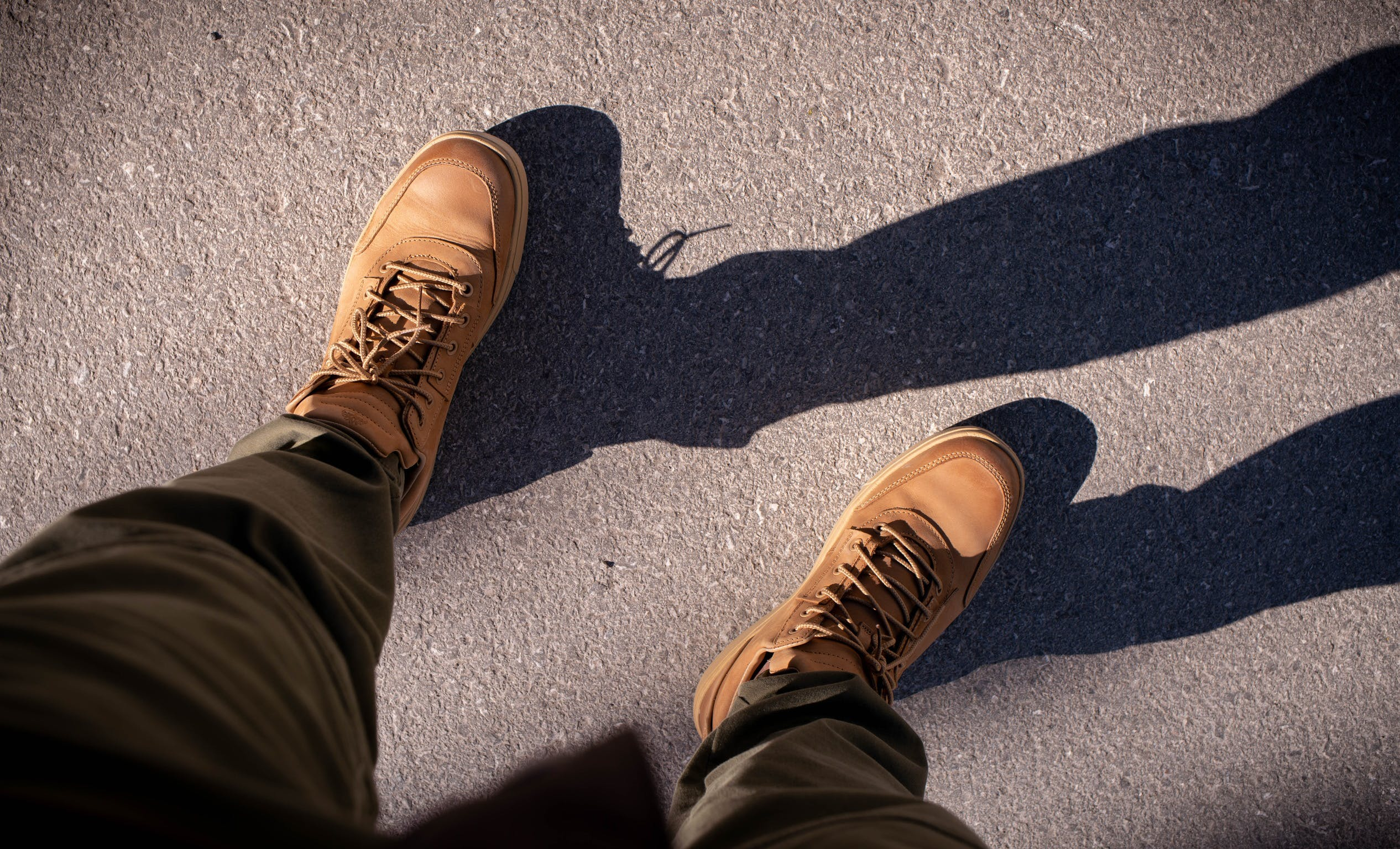 Free stock photo of legs, shoes, shadow, stand