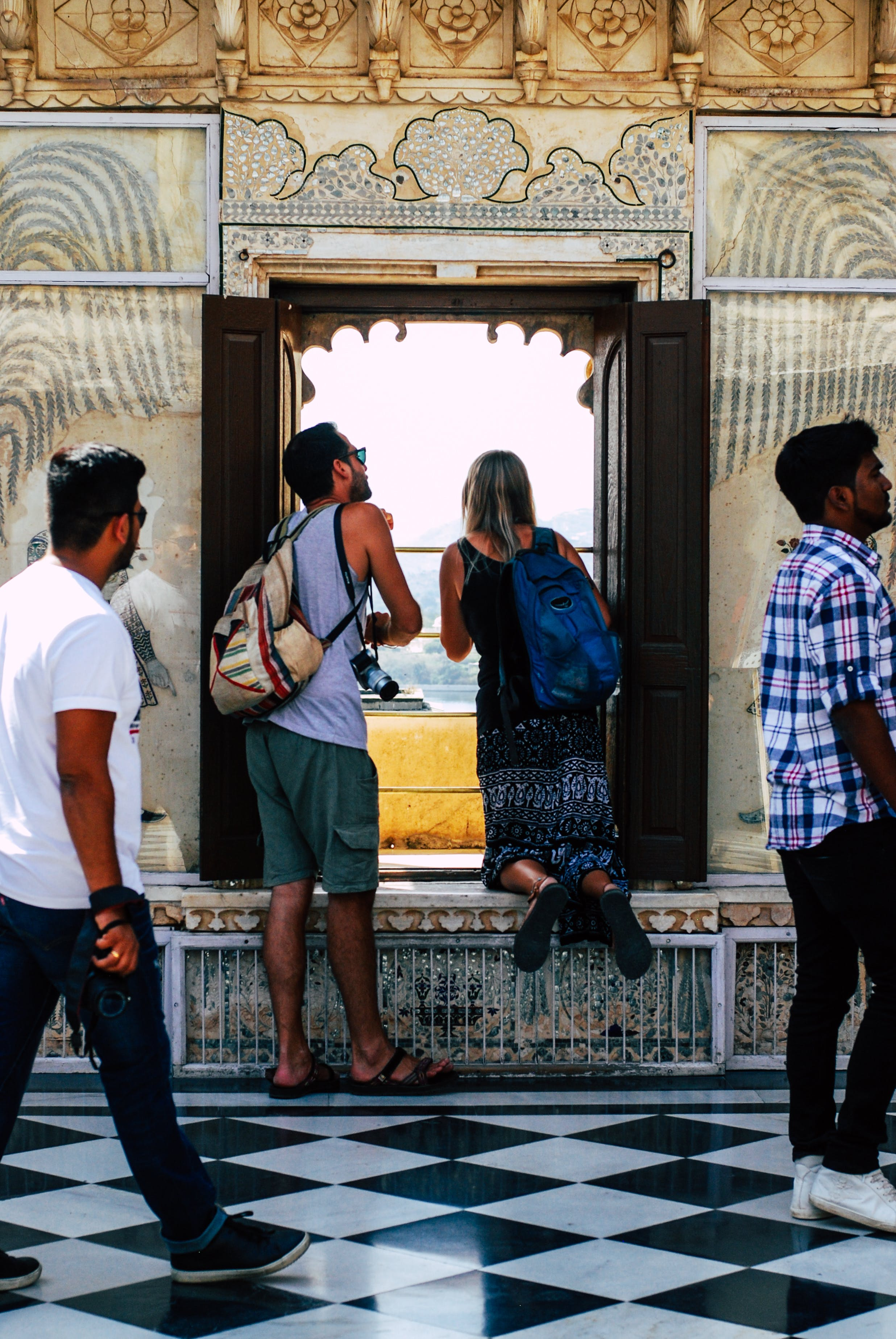 Photo of Man and Woman Looking at the Window