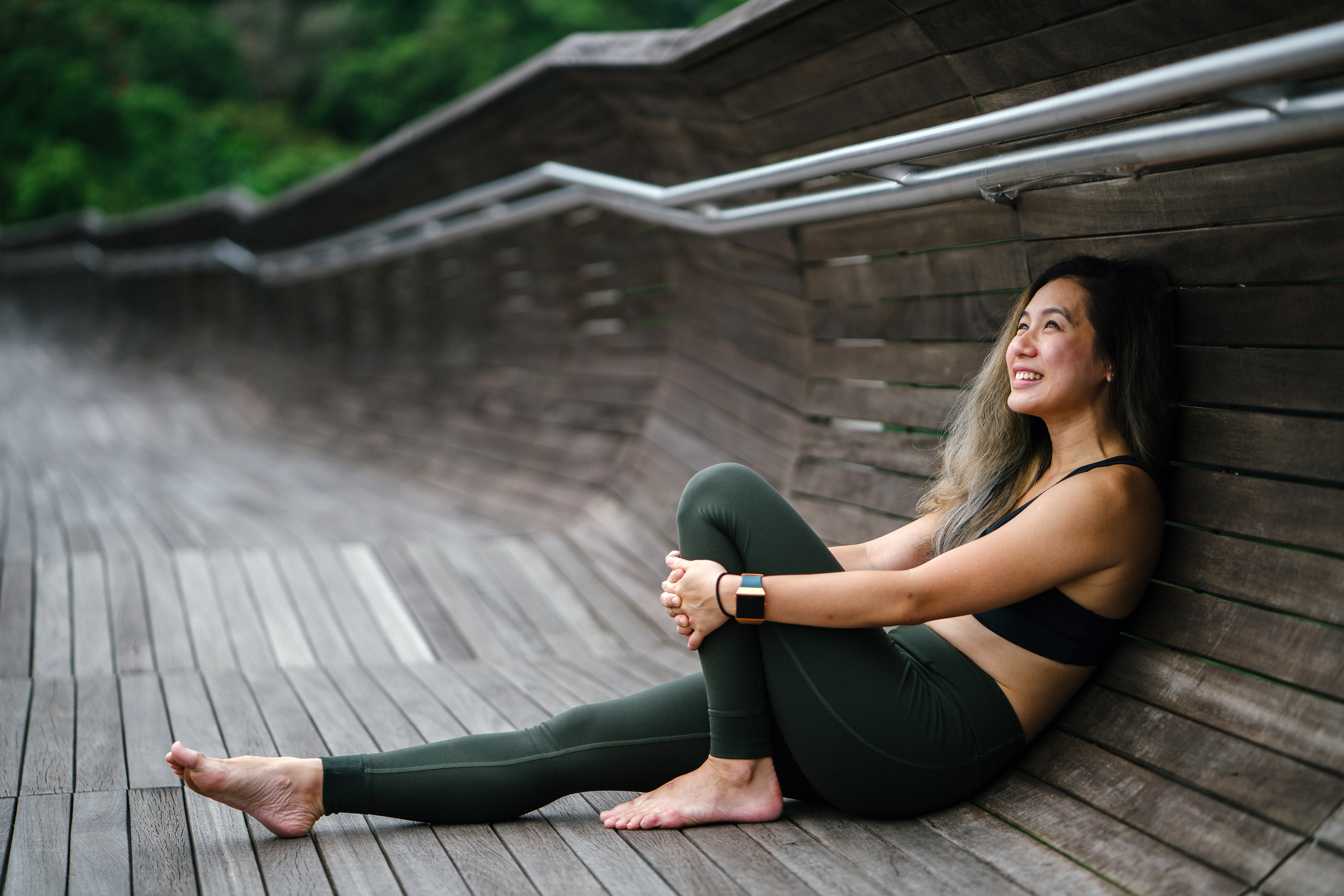 Photo of Smiling Woman Woman in Black Sports Bra and Black Leggings