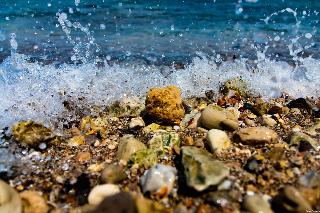 Close-Up Photography of Wet Rocks