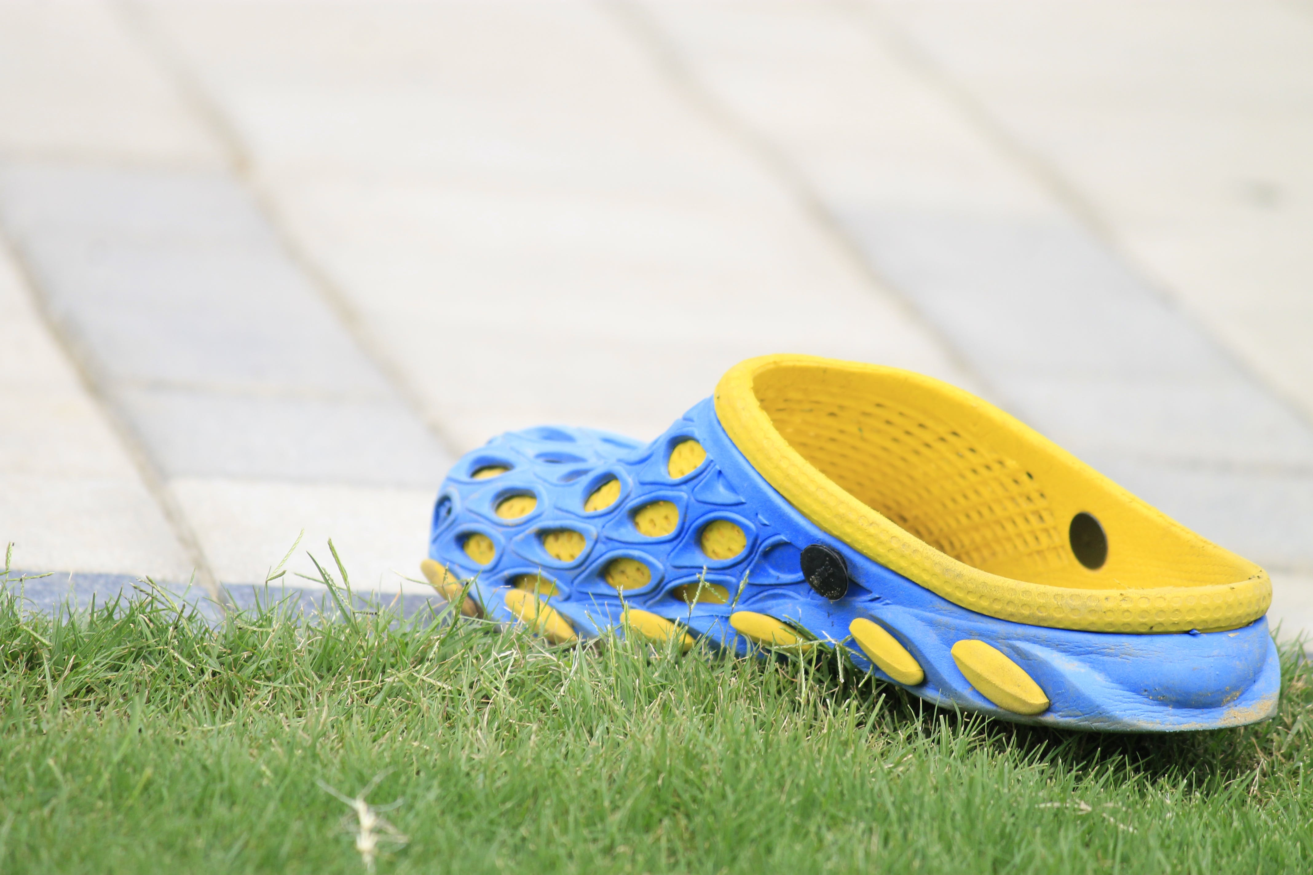 Close-up Photography of Rubber Clog