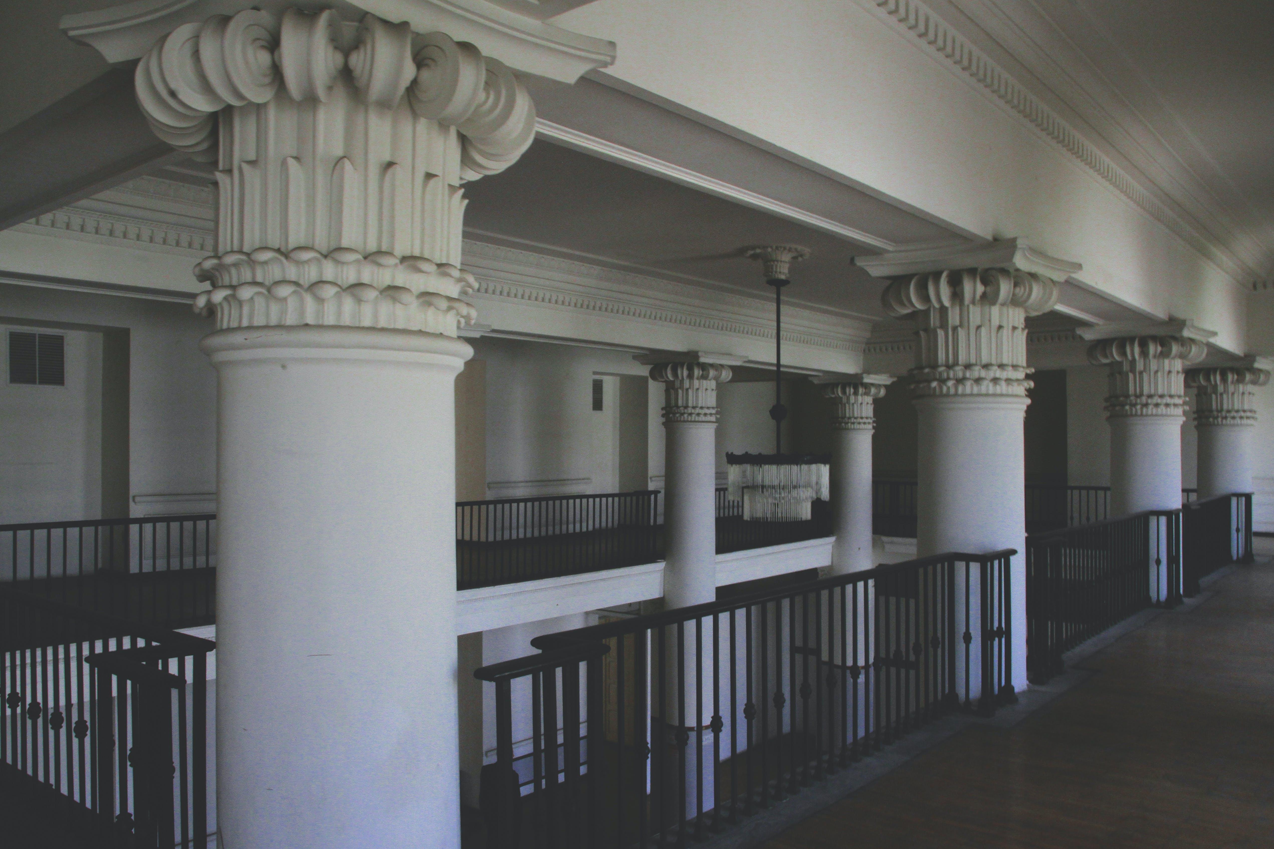 Photo of White Columns Near Railings