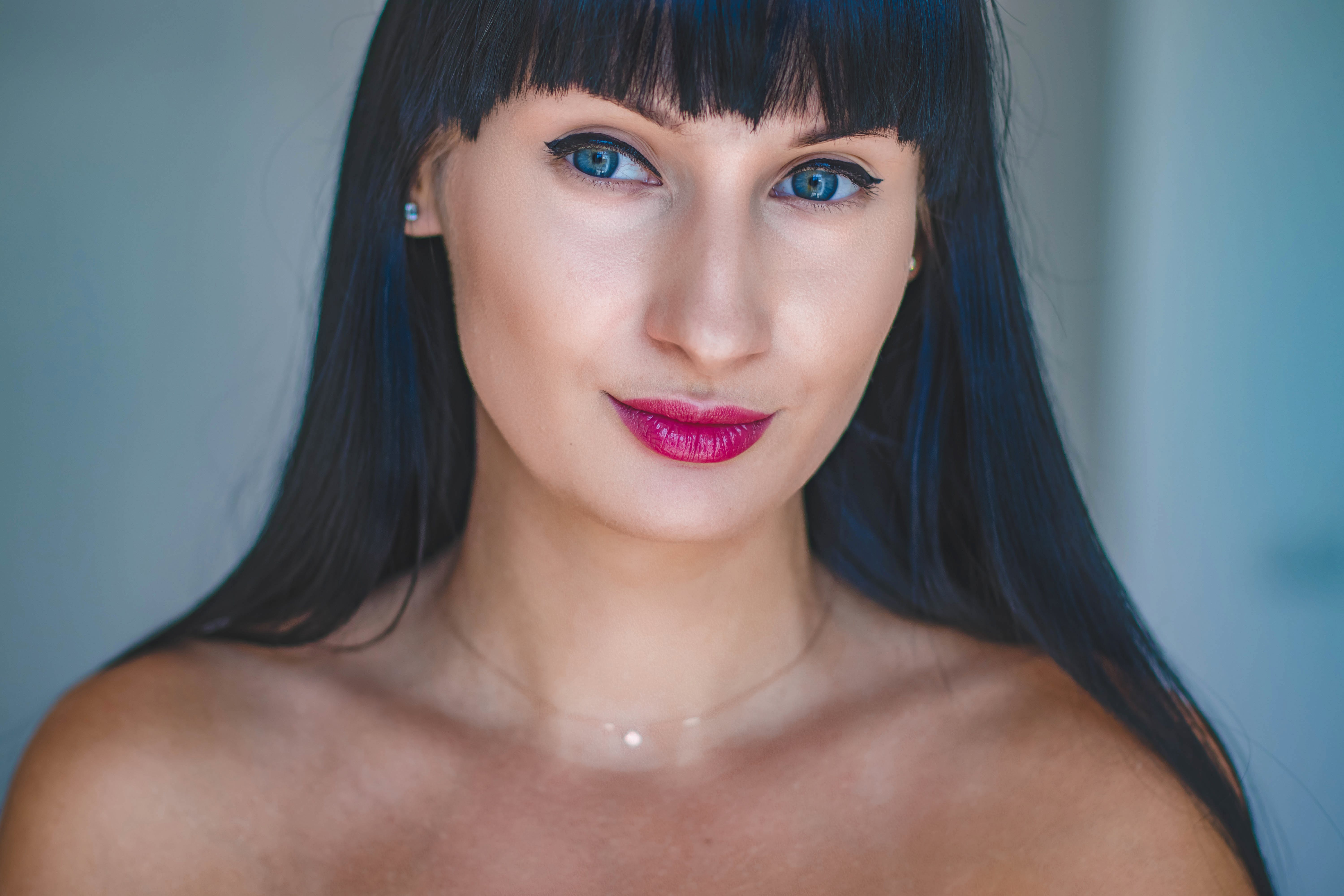 Photo of Woman With Blue Eyes and Black Hair