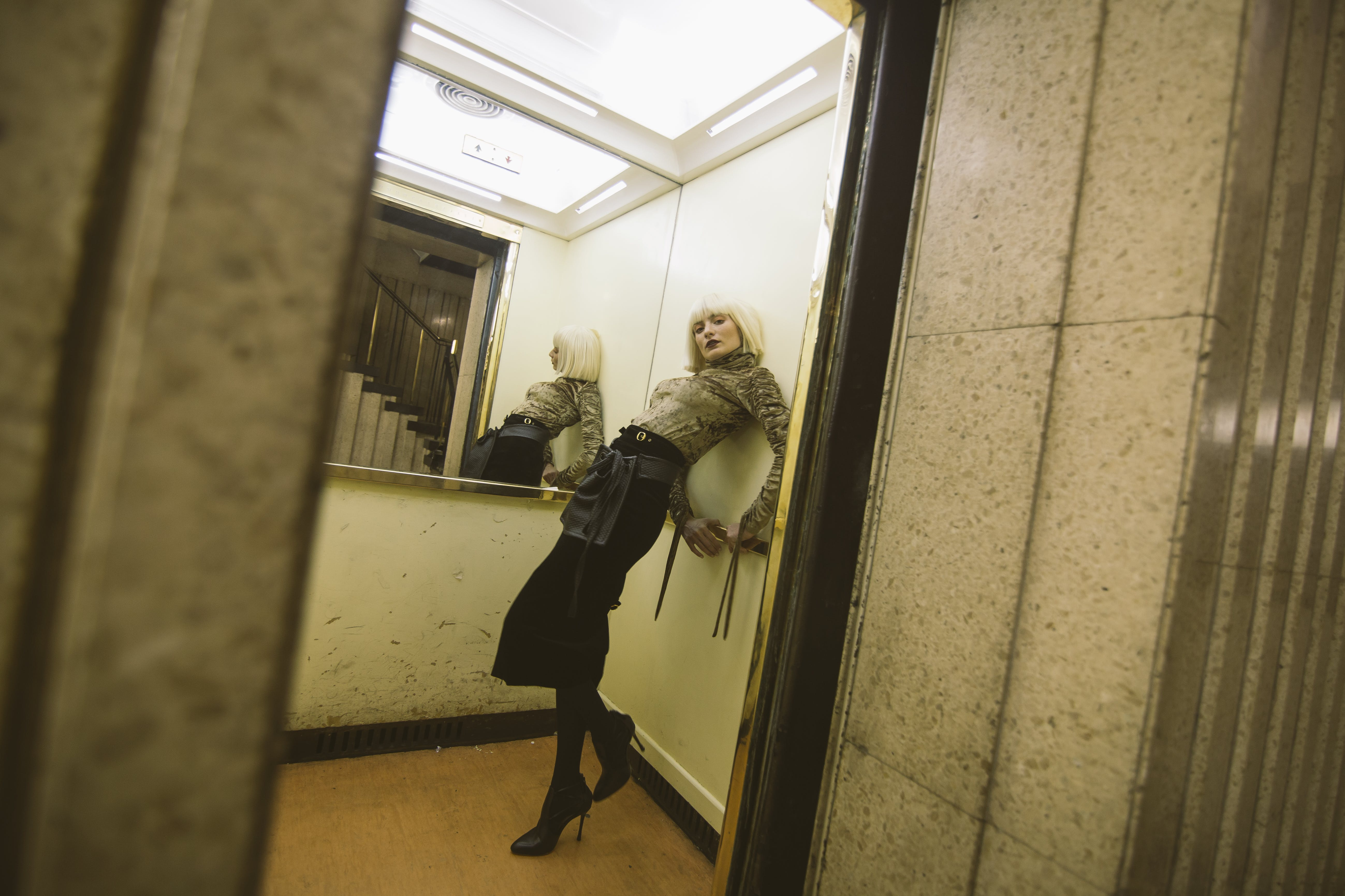 Photography of a Woman on Elevator