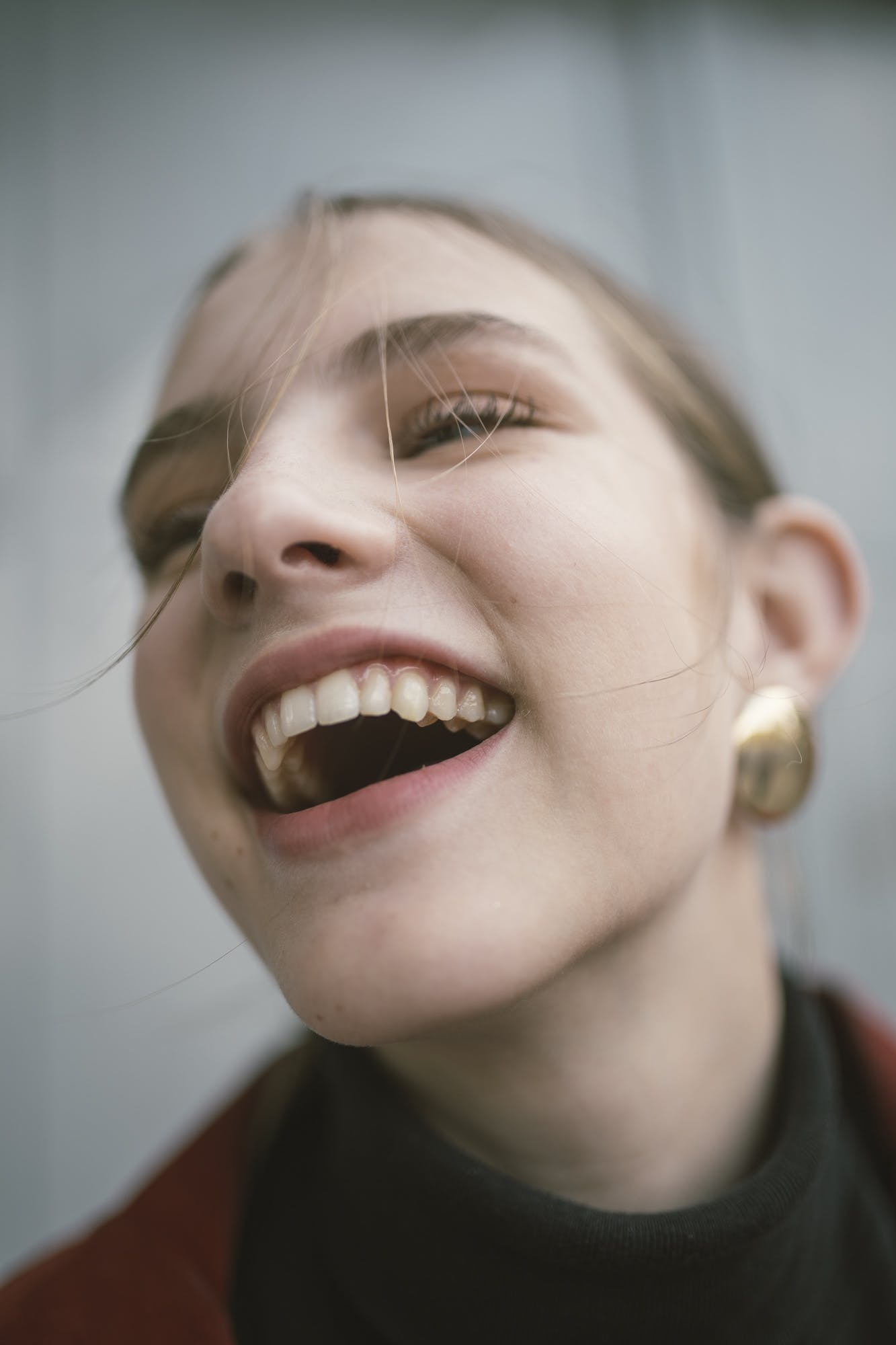Close-Up Photography of a Laughing Woman