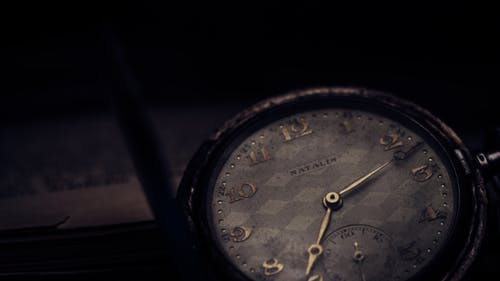 Close-up Photography of Vintage Watch