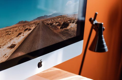 Close-Up Photography of iMac Turned On