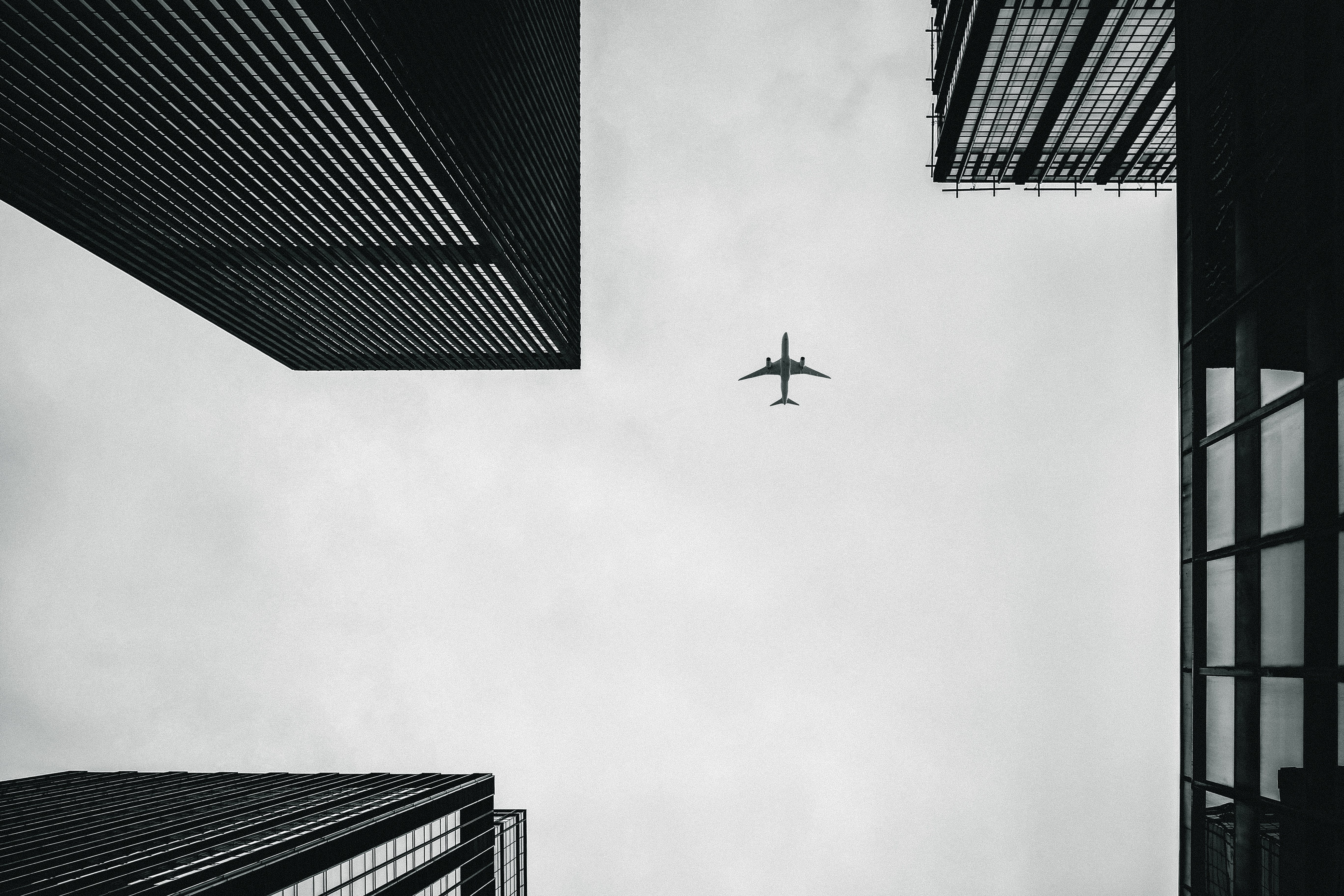 Low Angle Photography of Airplane And Buildings